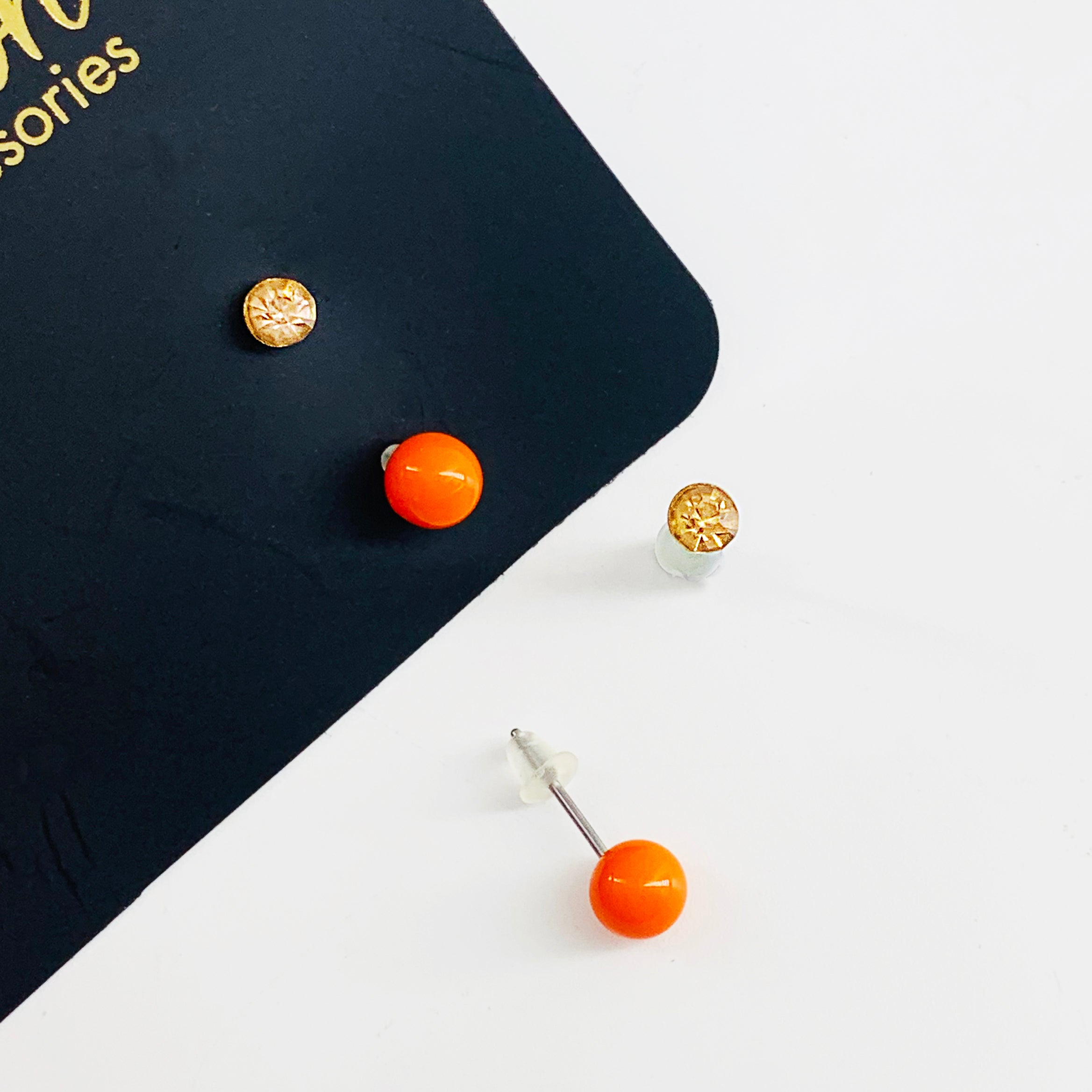 Small orange gem and ball earrings