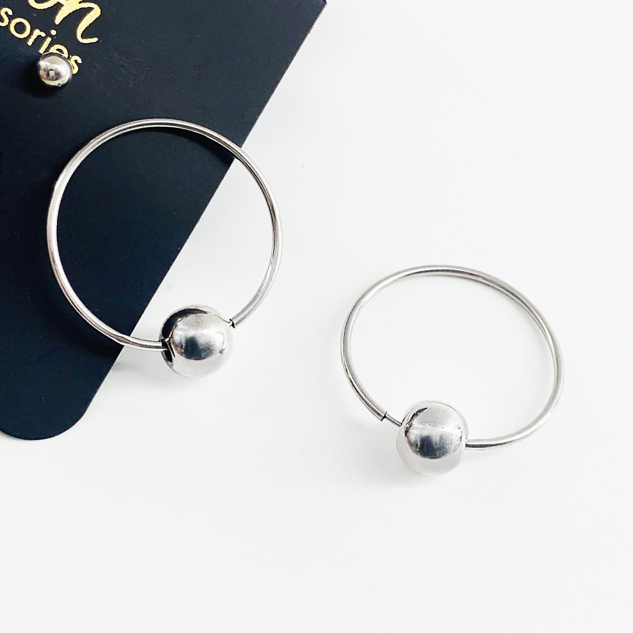 Silver hoop earrings with silver ball