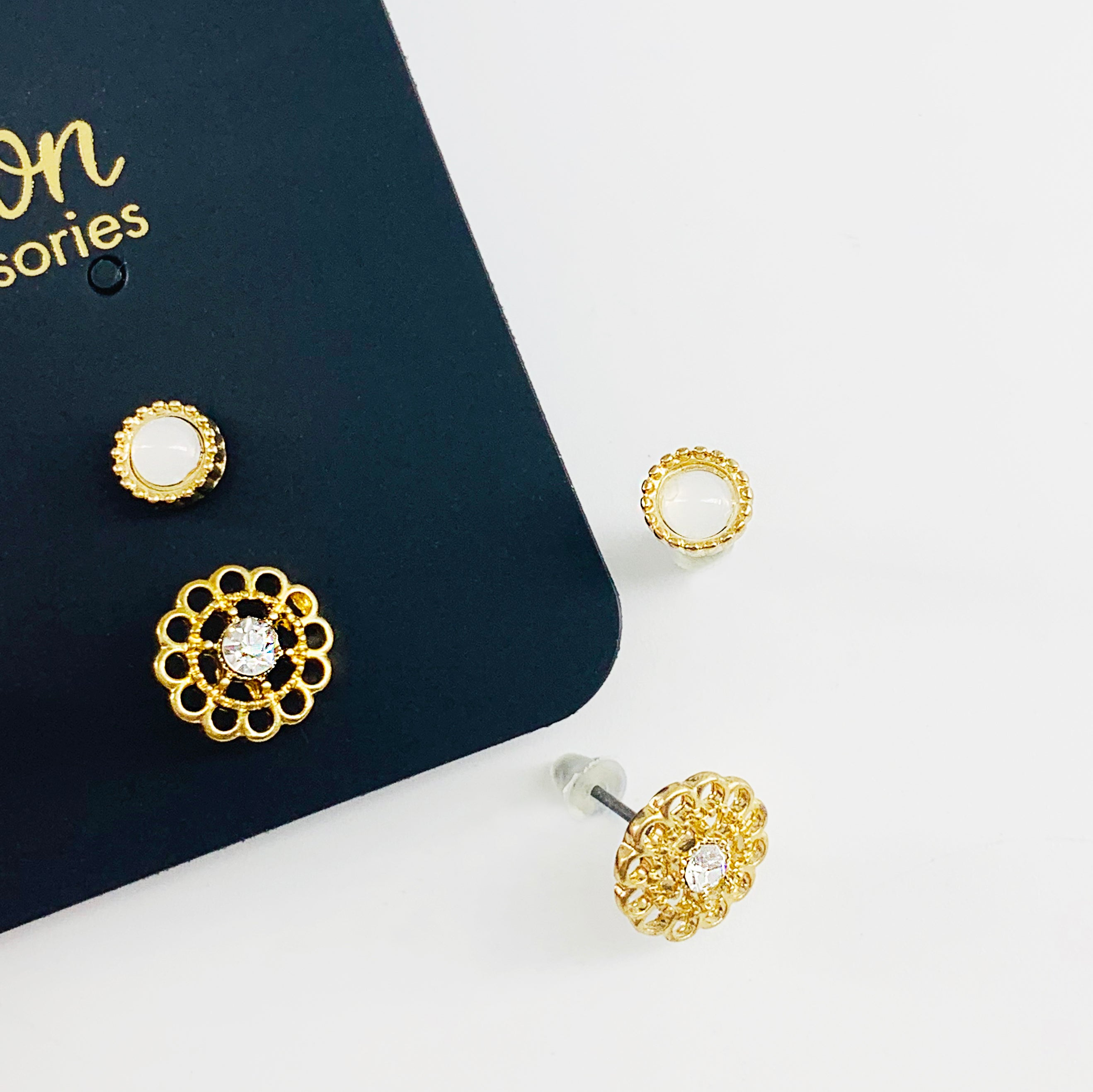 Small gold flower and opal ear studs