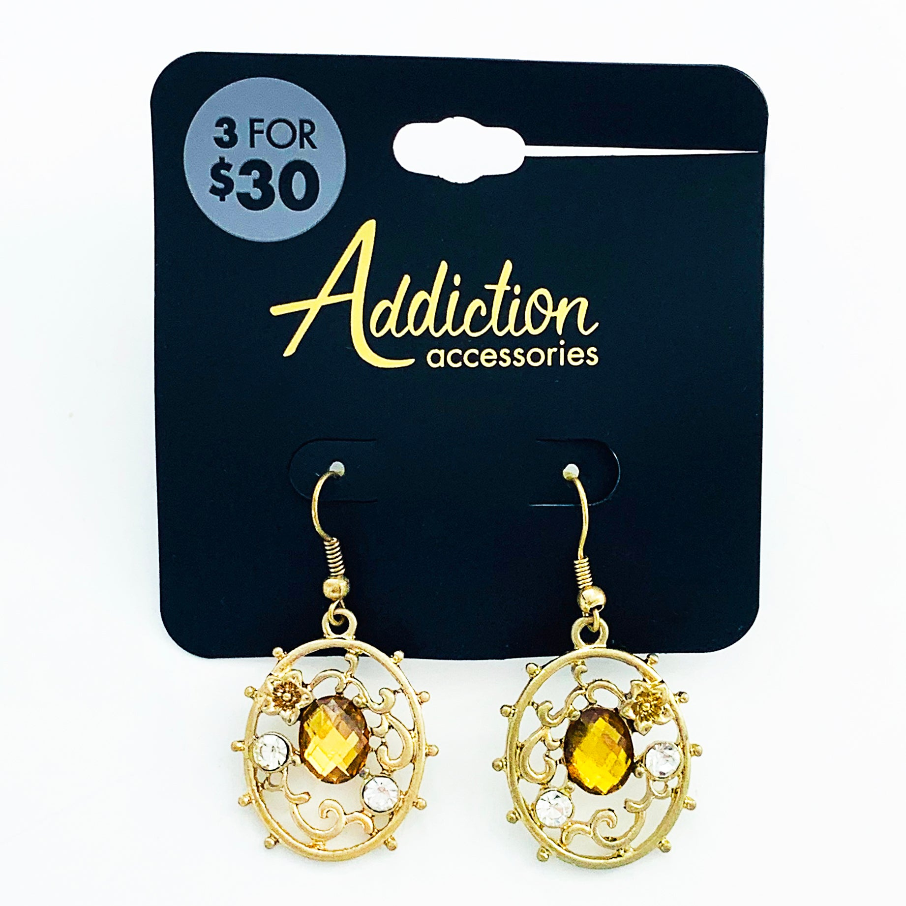 Ornate earrings with yellow facet gems