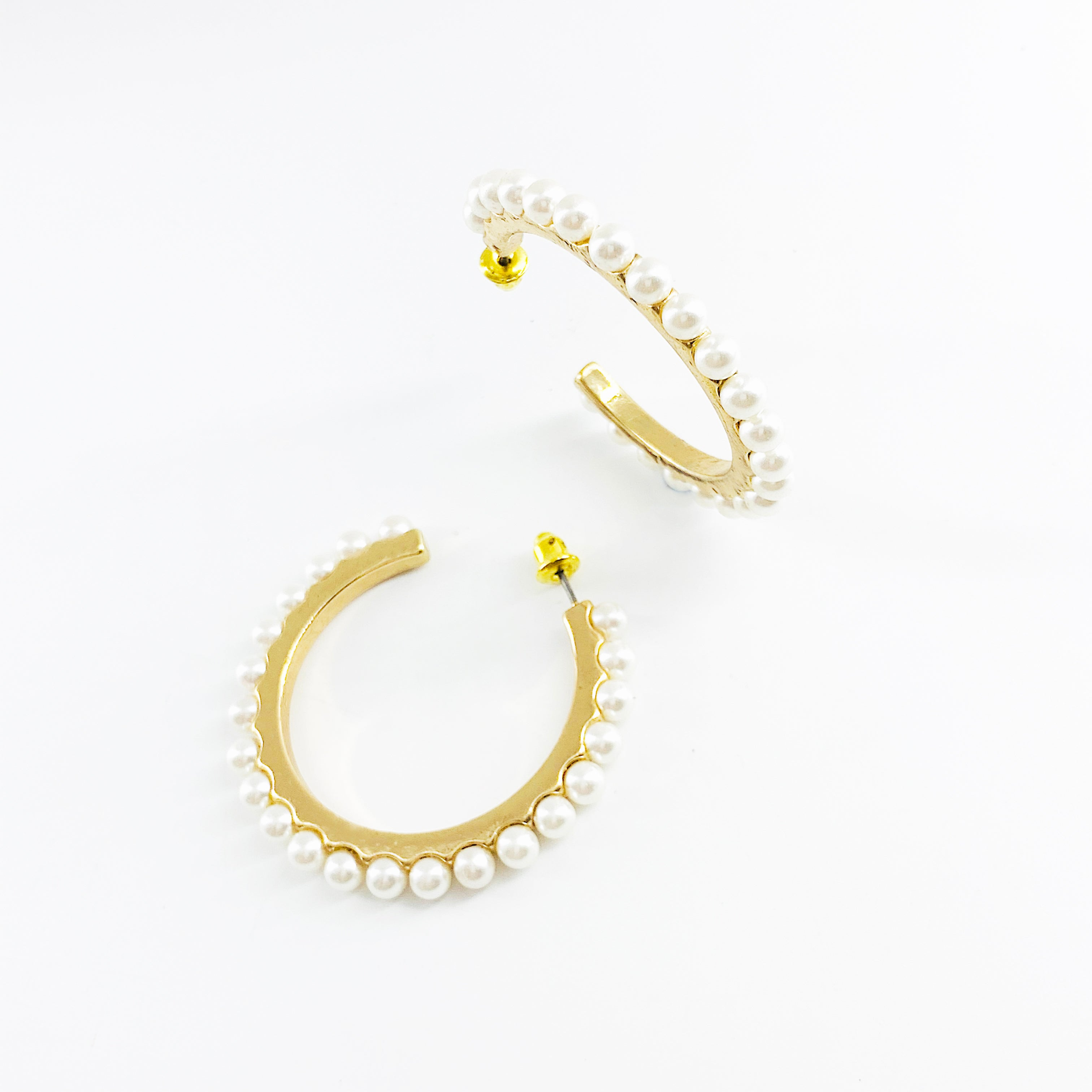 Gold hoop earrings with row of pearls