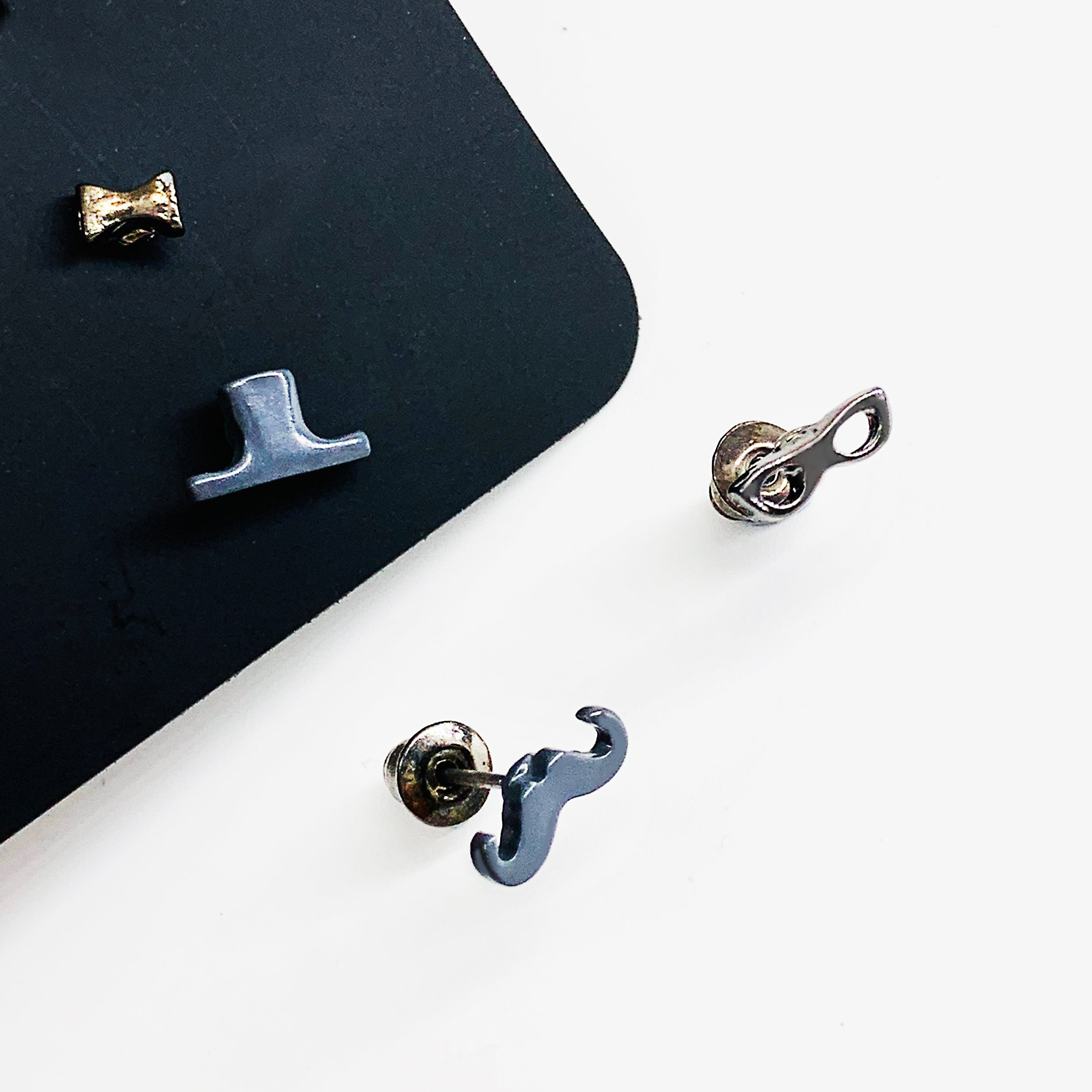 Mustache, hat and sunglasses ear studs in grey