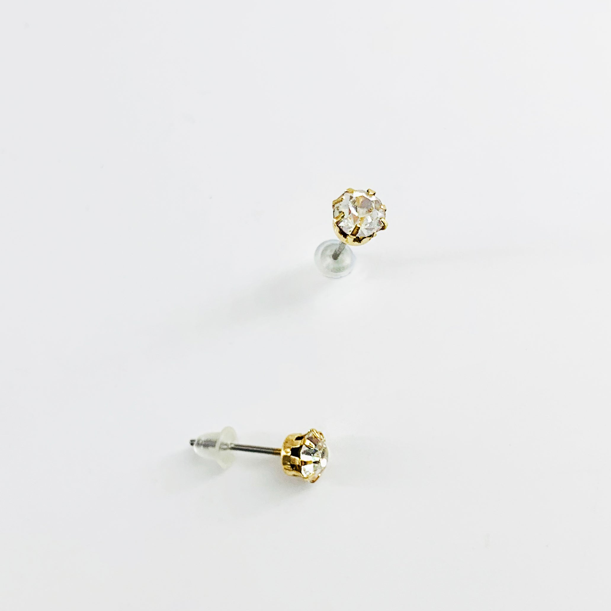Diamante stone gold ear studs