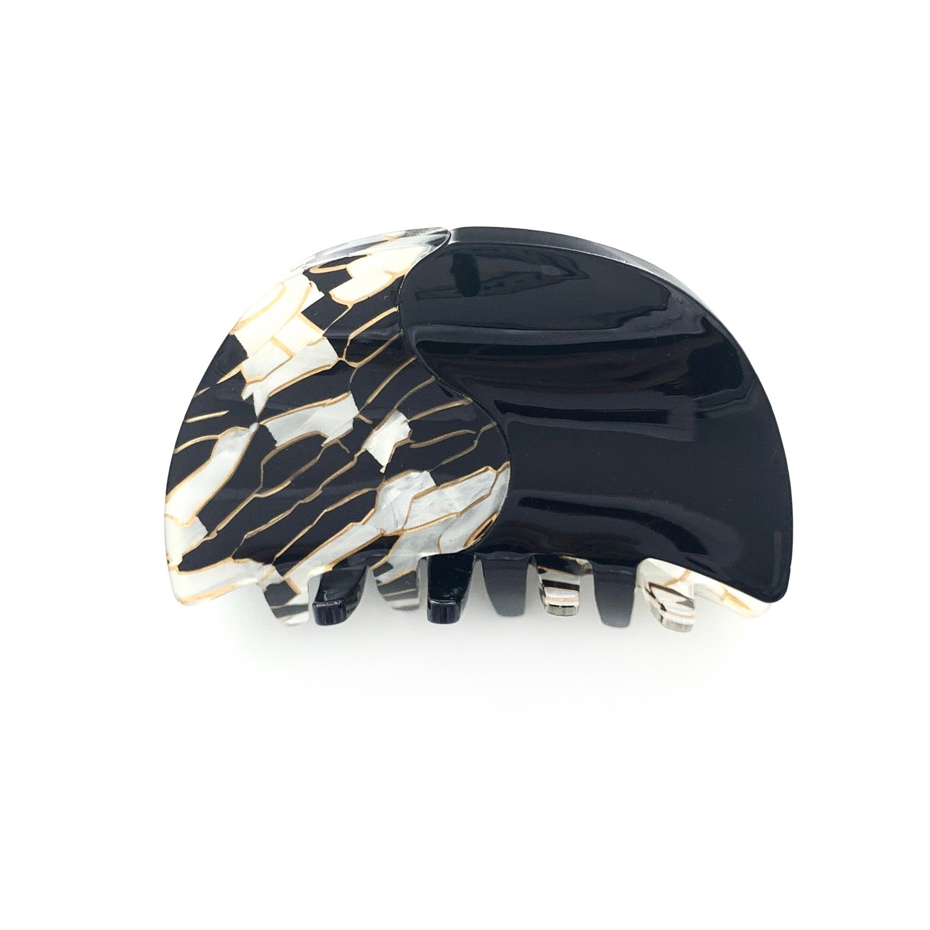 Black hair clip with gold and white pearly patterns - rounded
