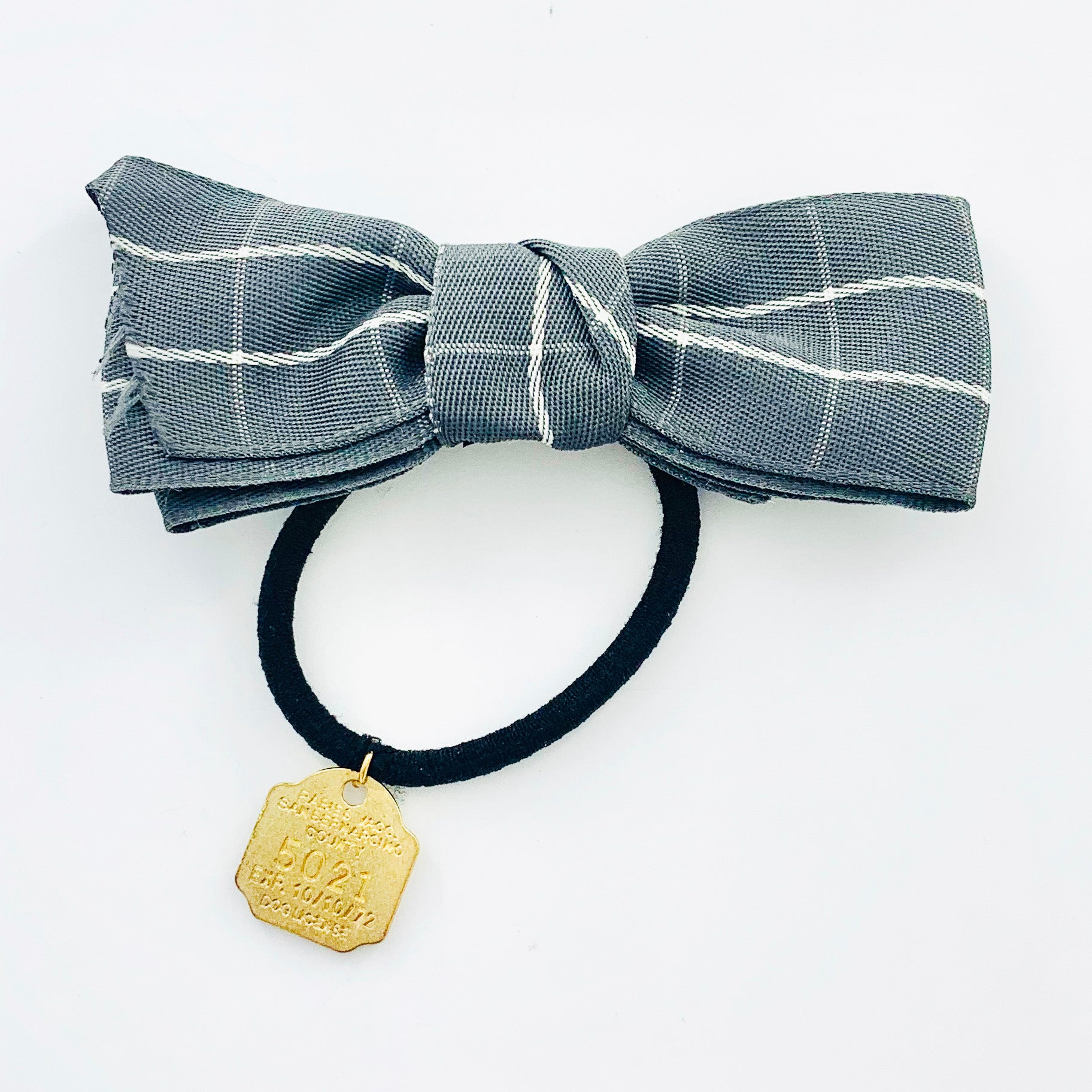 Hair tie with grey fabric ribbon and gold charm detail