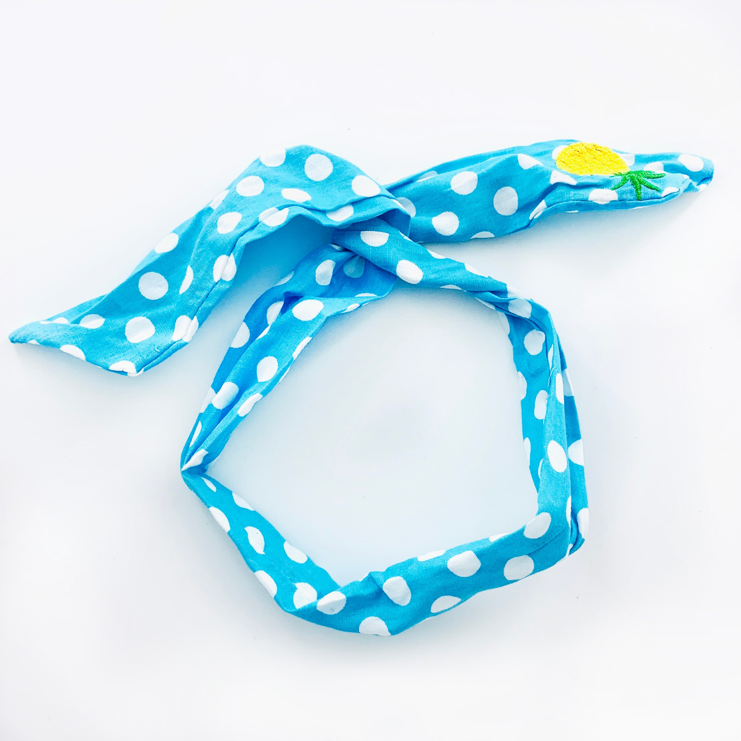 Blue polka-dot wired hairband with embroidered pineapple