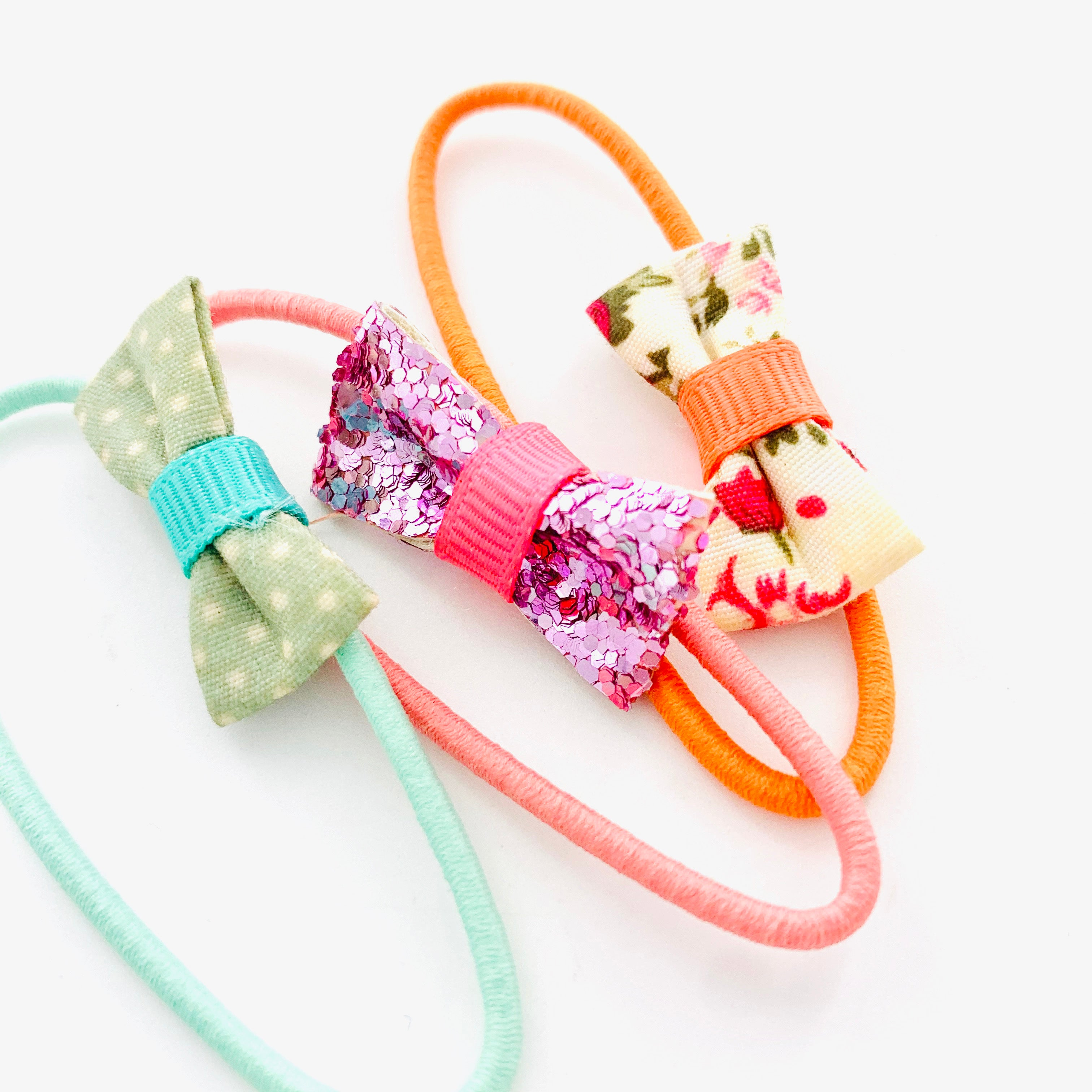 Coloured rubber bands with fabric and sequin ribbons
