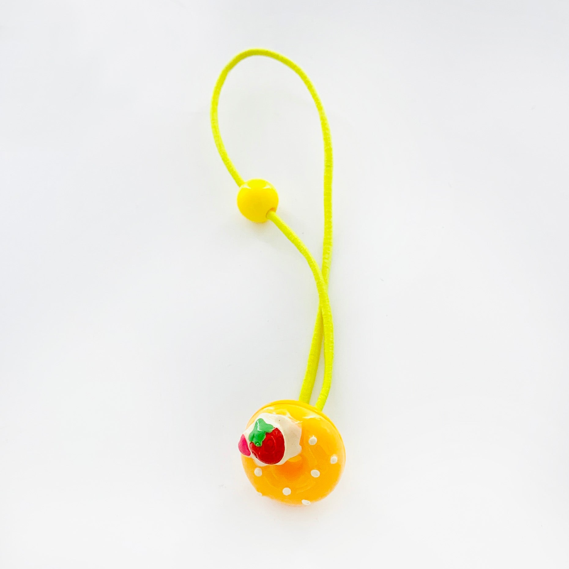 Yellow rubber band with donut