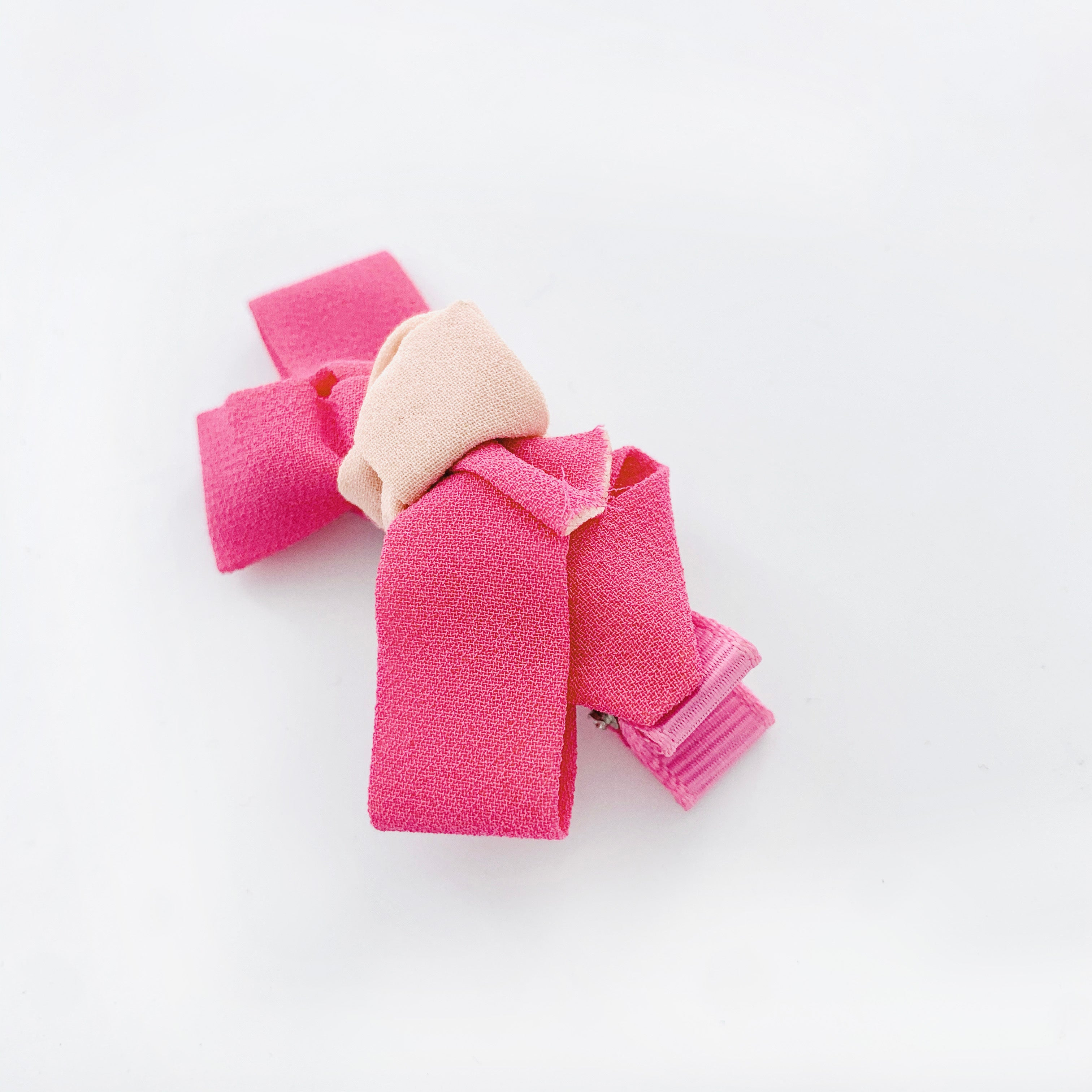 Hair clip with pink ribbon