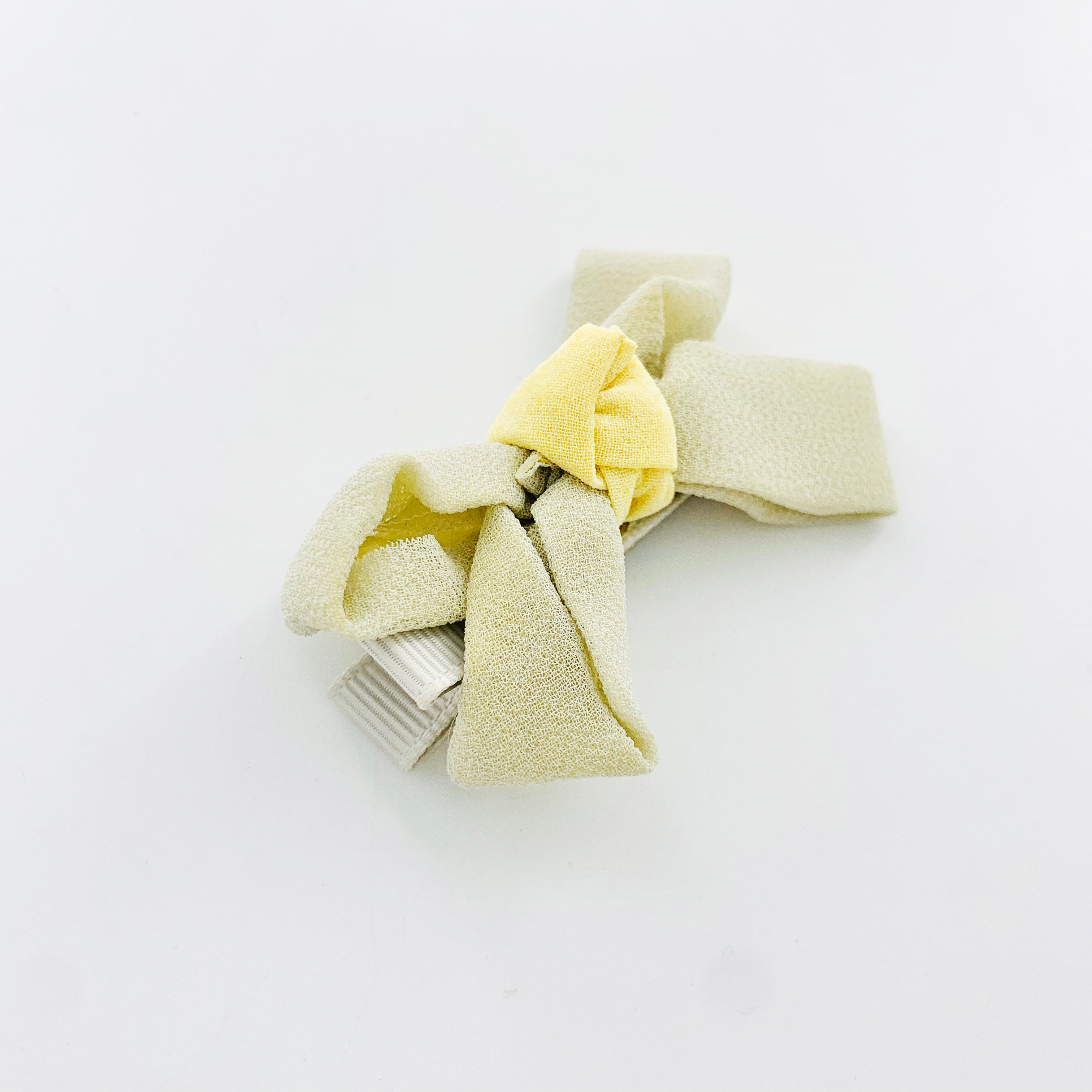 Hair clip with grey ribbon