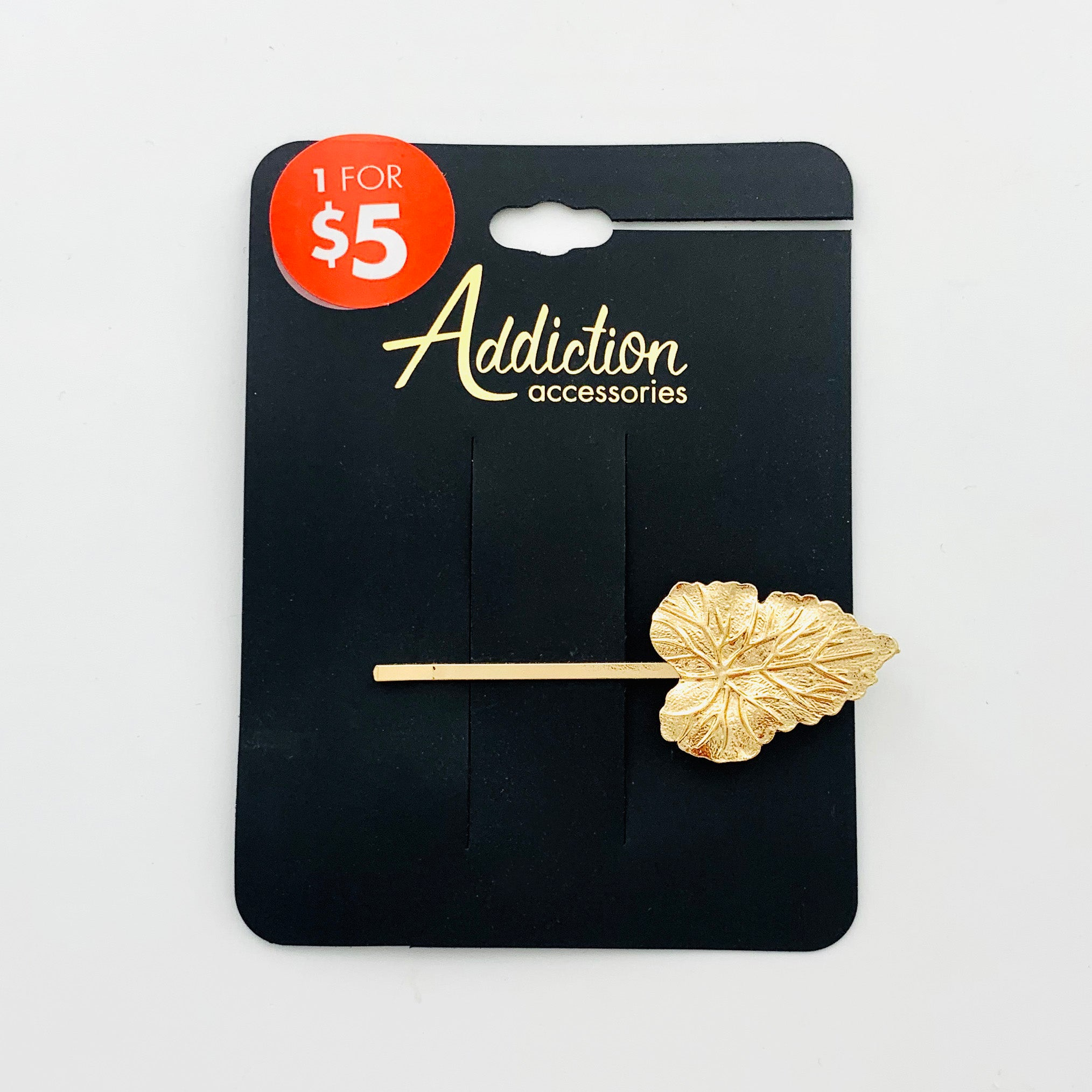 Gold hair clip with leaf