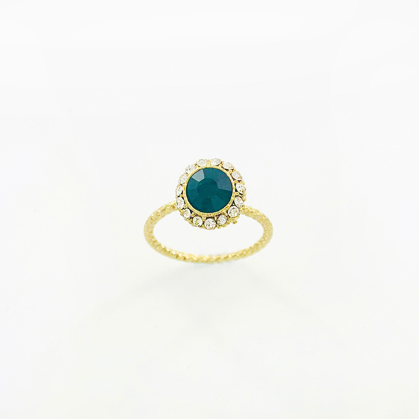 Emerald coloured crystal with diamante stones on textured gold ring