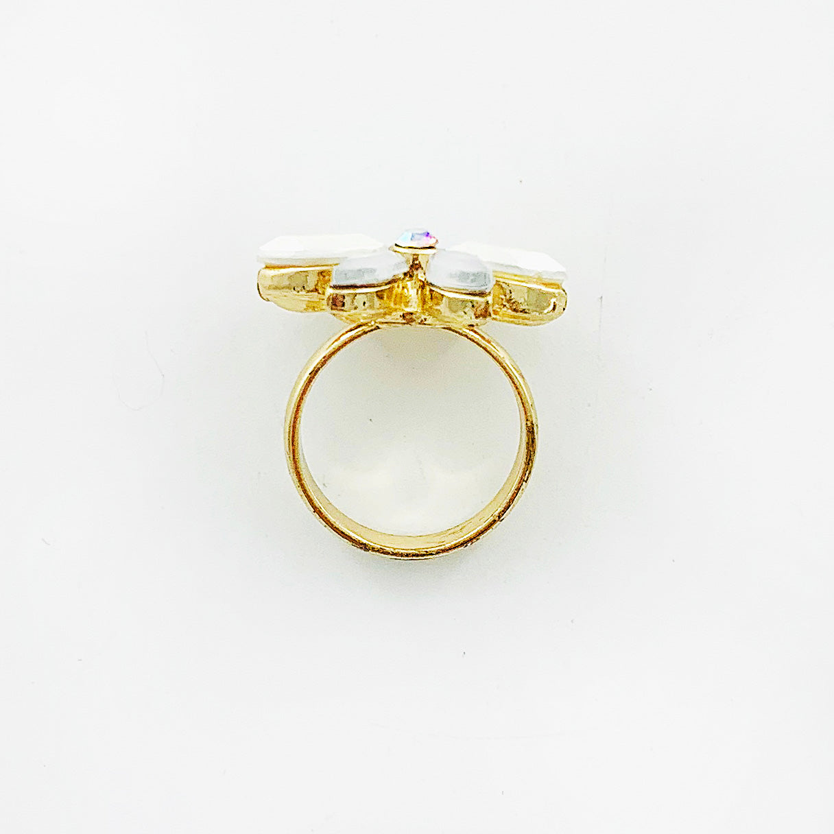 Gold ring with crystal flower petals