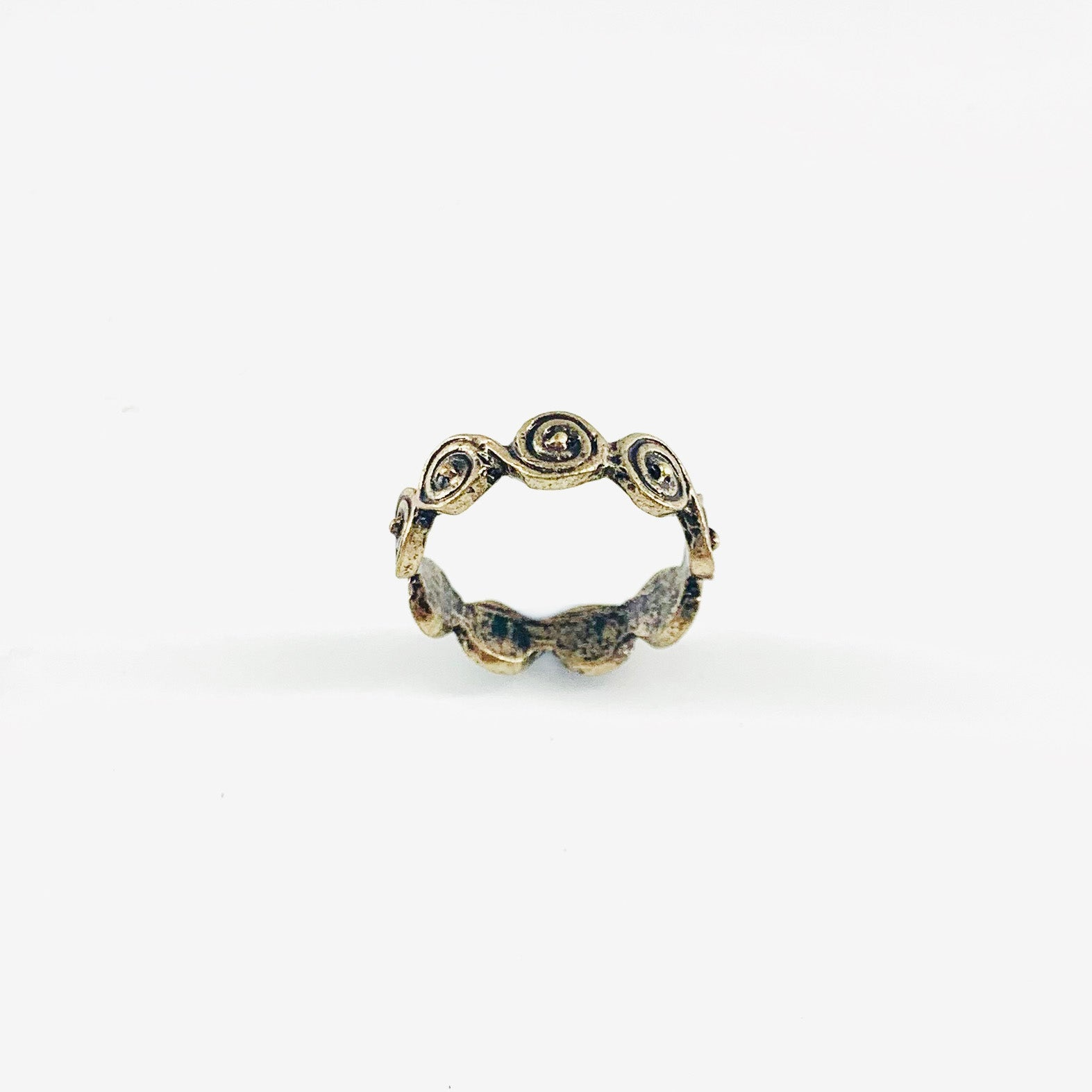 Vintage-styled ring with circular design patterns