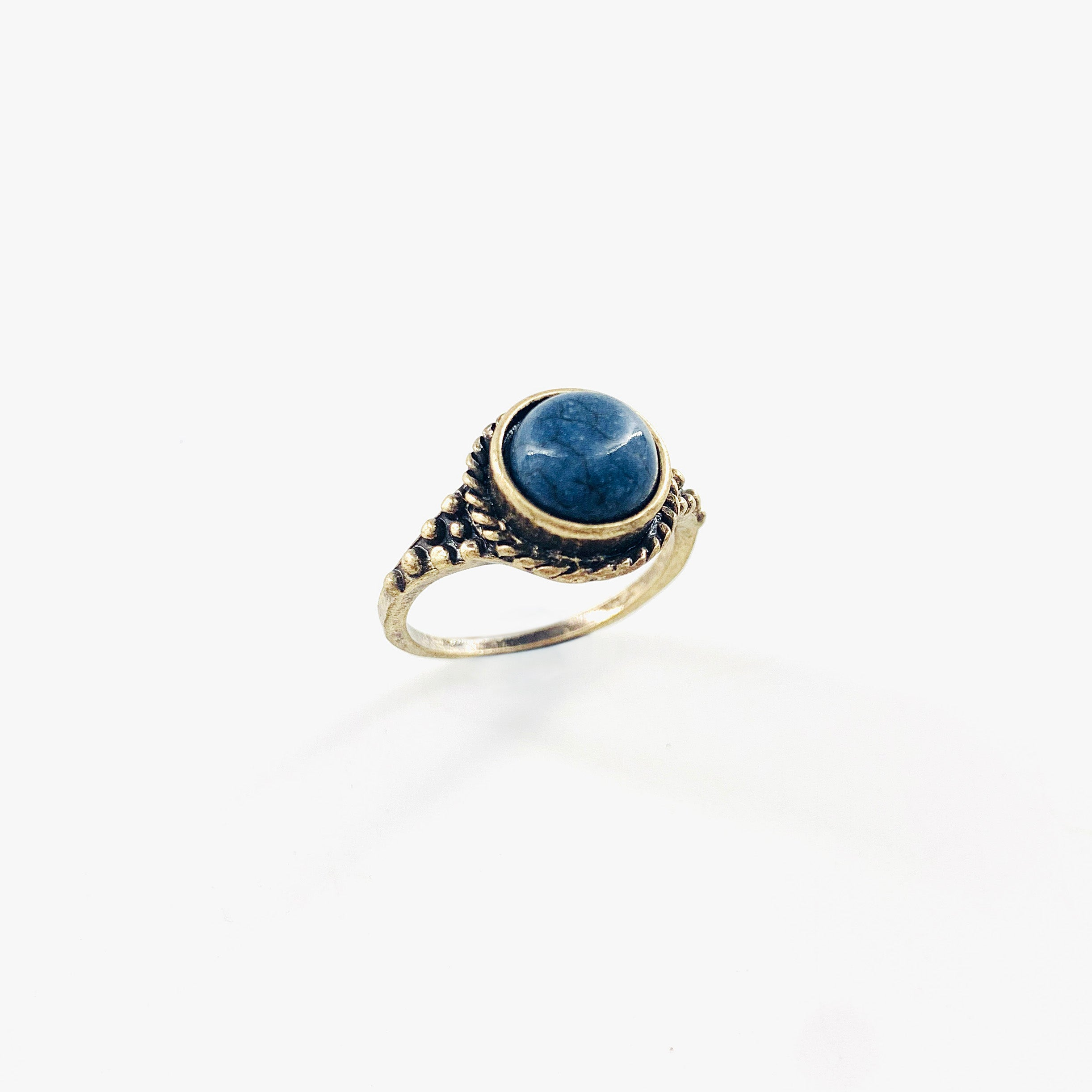 Vintage-styled ring with small blue stone and delicate band