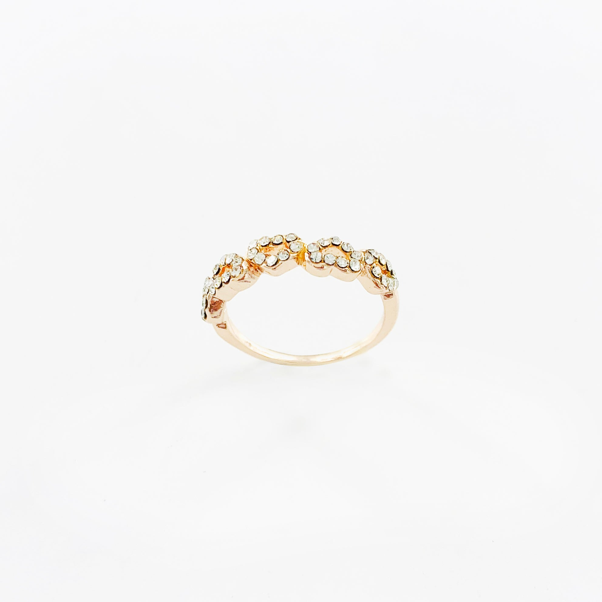 Rose gold coloured ring with diamante hearts