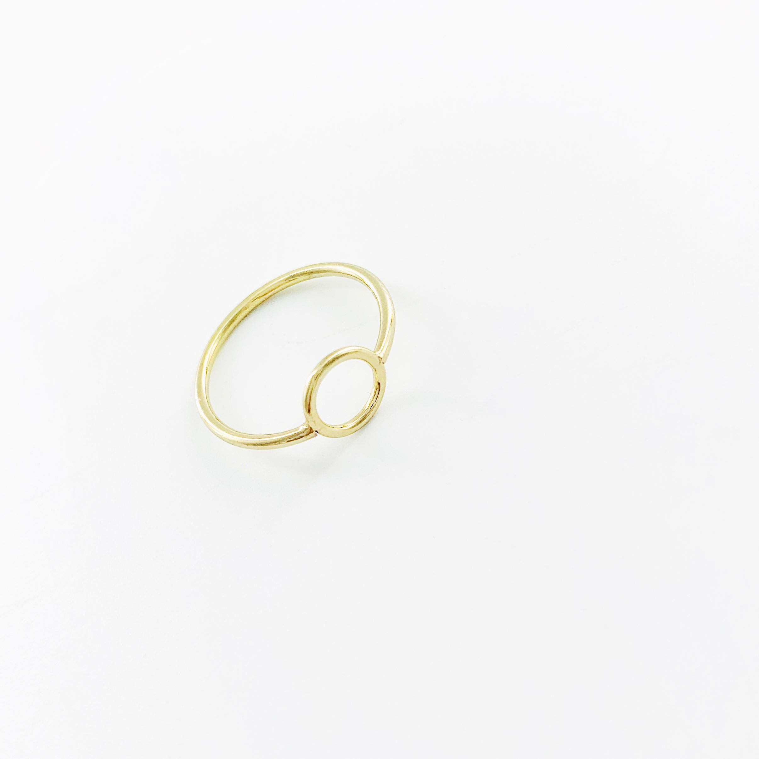 Thin gold ring with hollow circle design