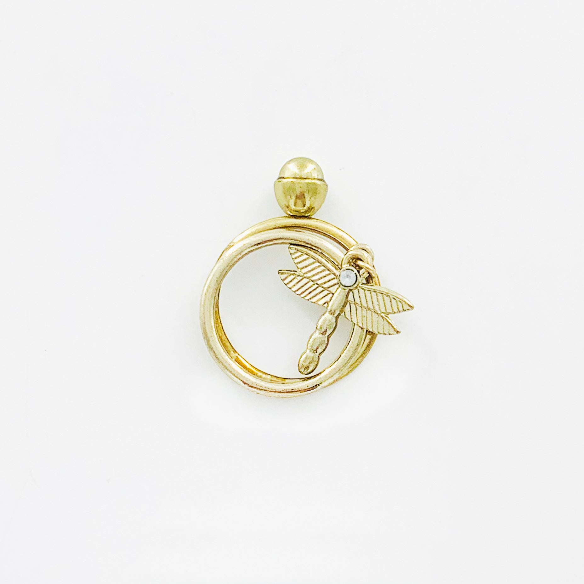 Thin gold rings with dangling dragonfly charm