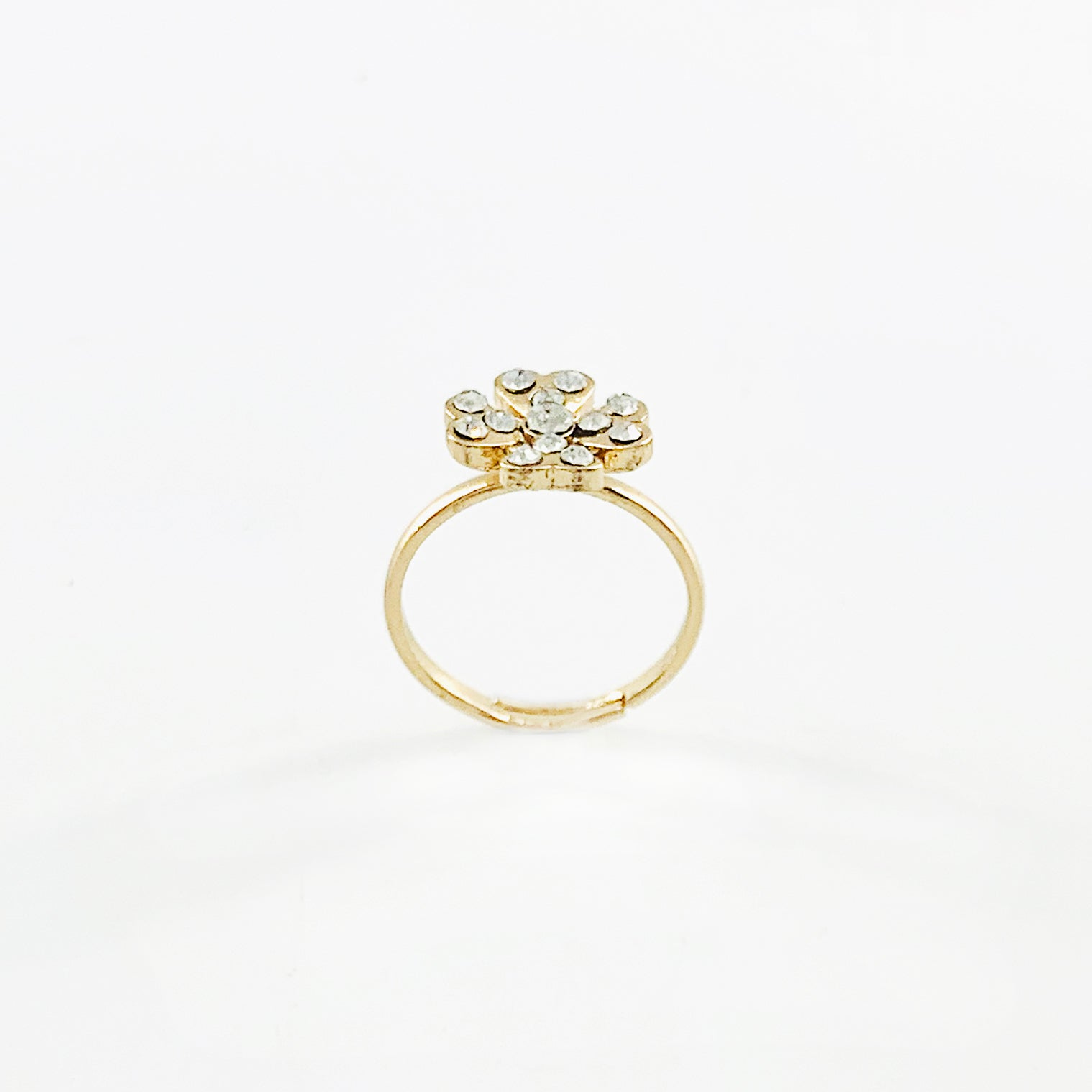 Gold and diamante flower ring