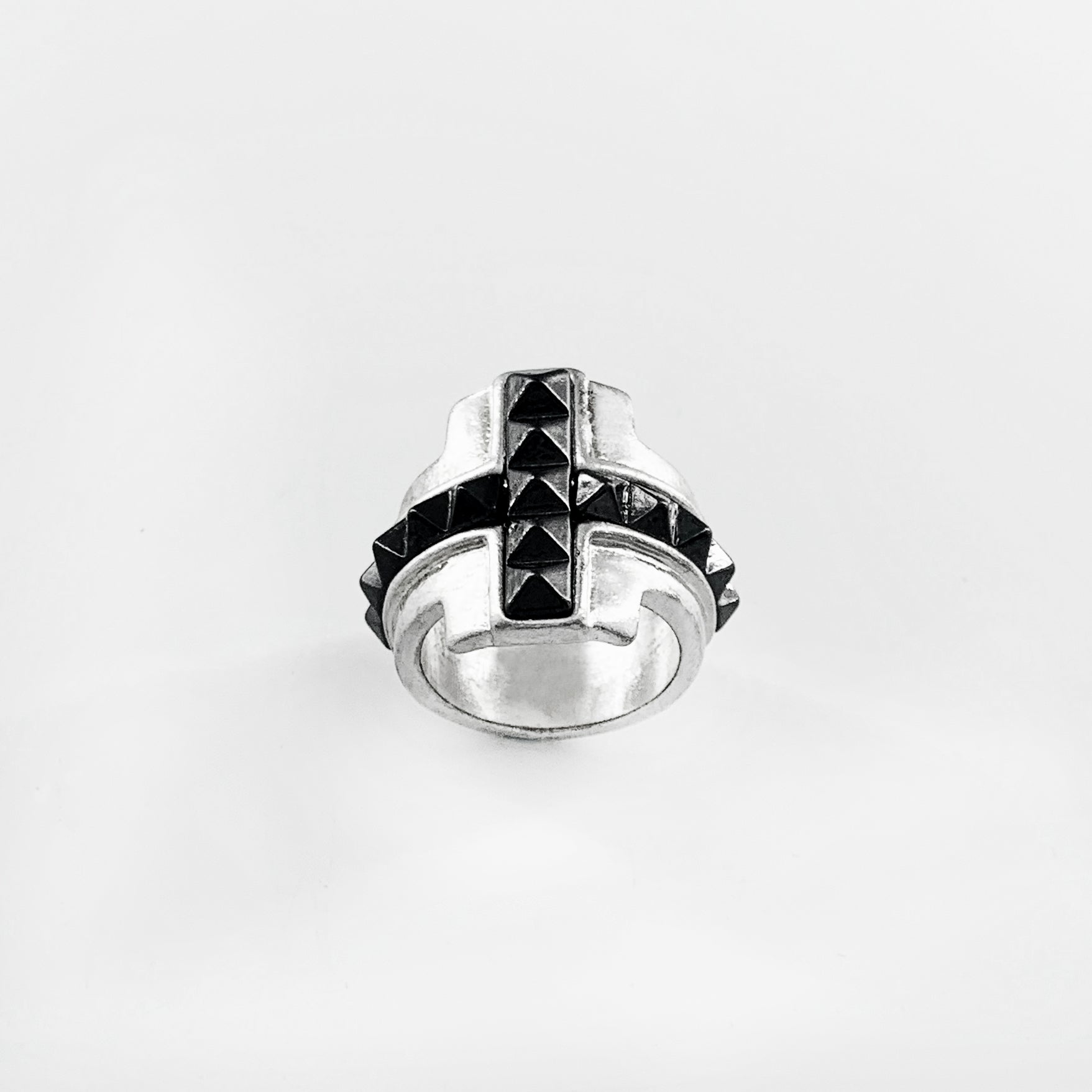 Silver ring with black studded cross