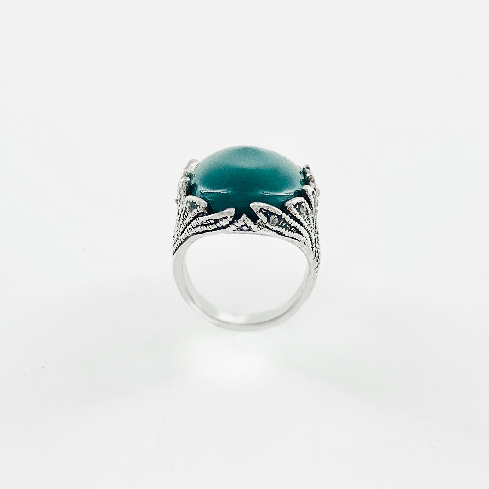 Art-deco inspired Silver ring with large green stone