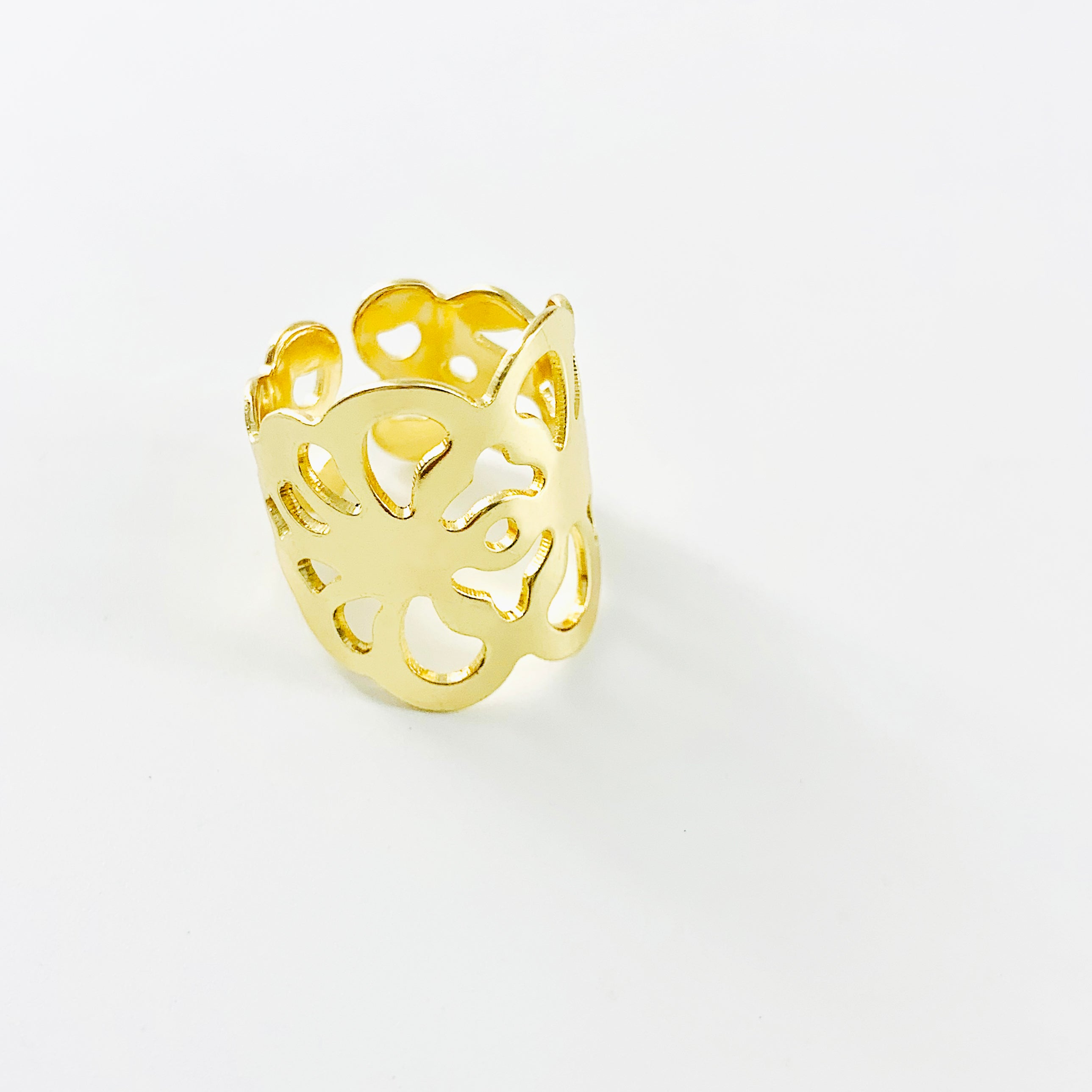 Wide gold ring with floral cut-out patterns