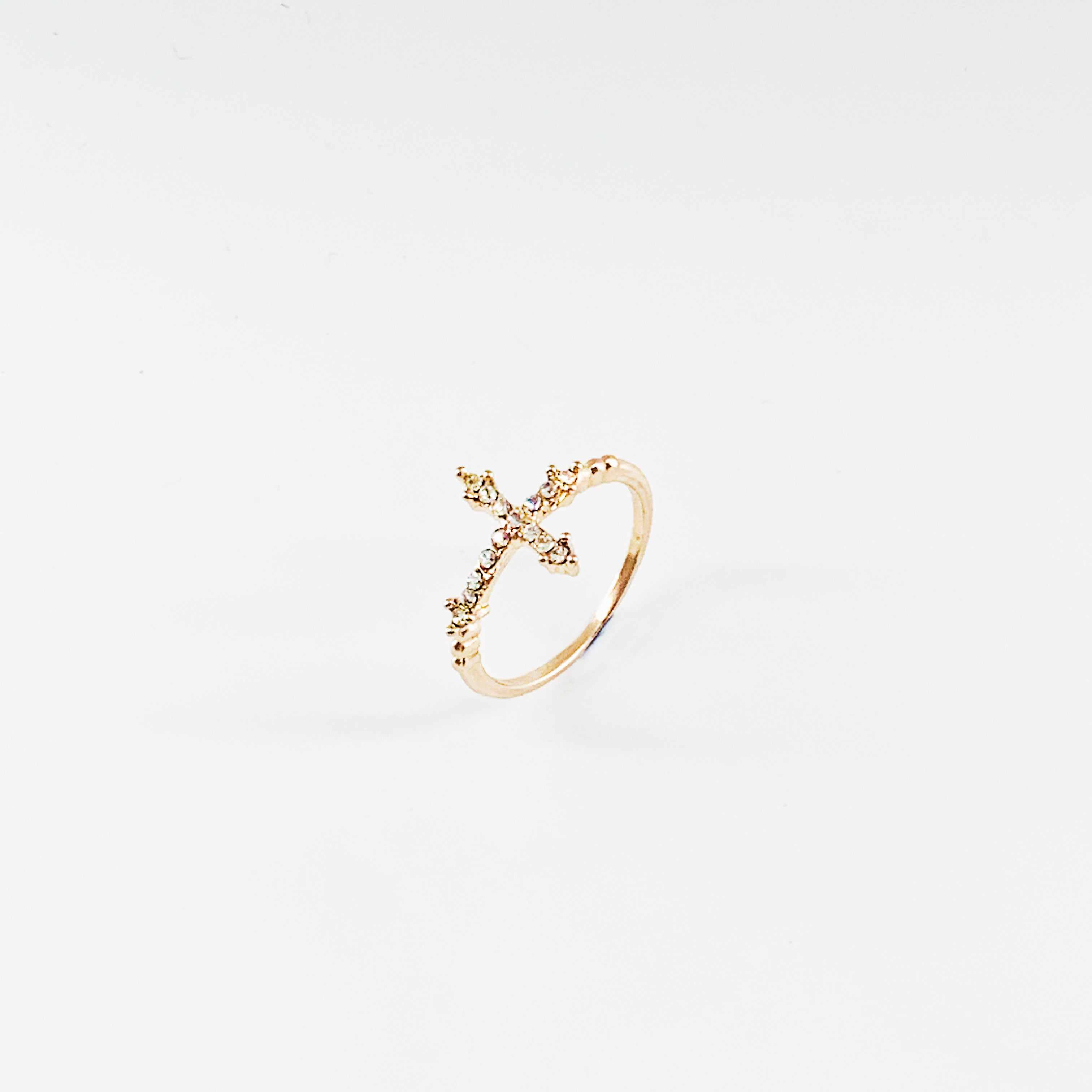 Thin rose gold band with diamante cross
