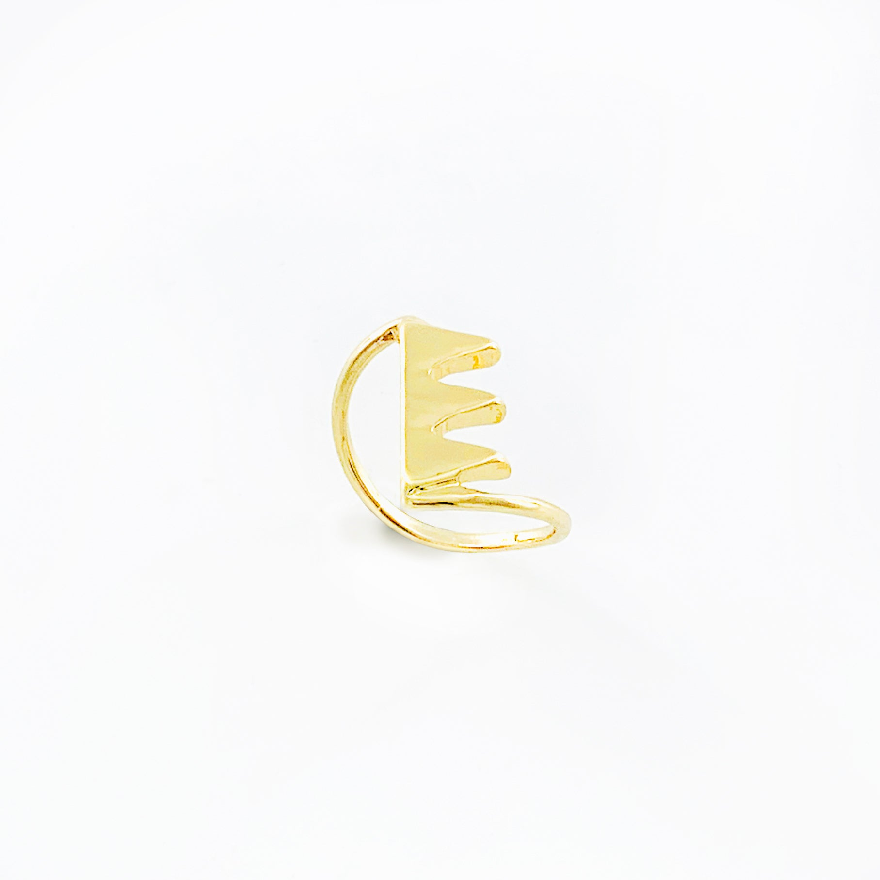 Gold ring with jagged tooth design