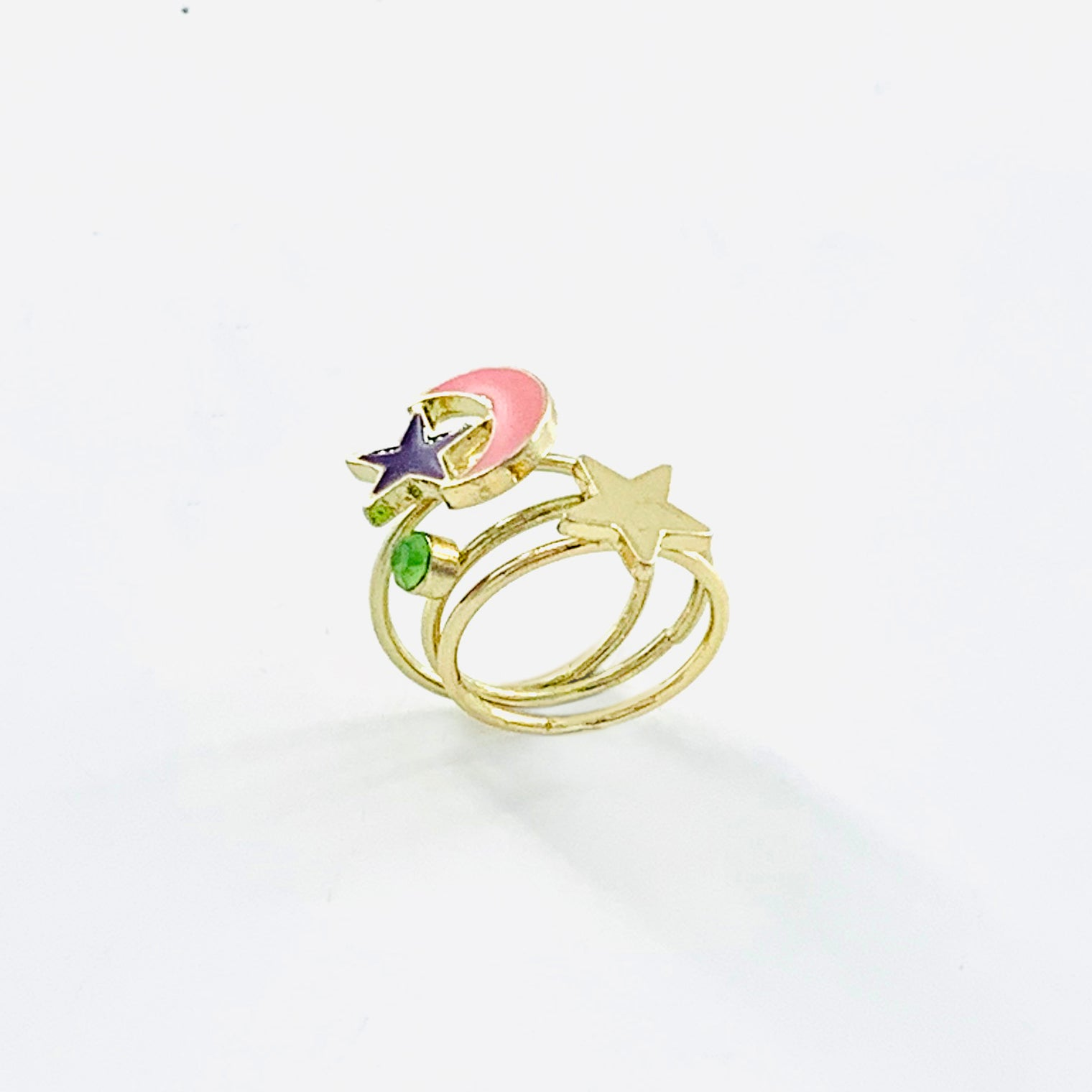 Gold pinky rings with pink crescent and stars
