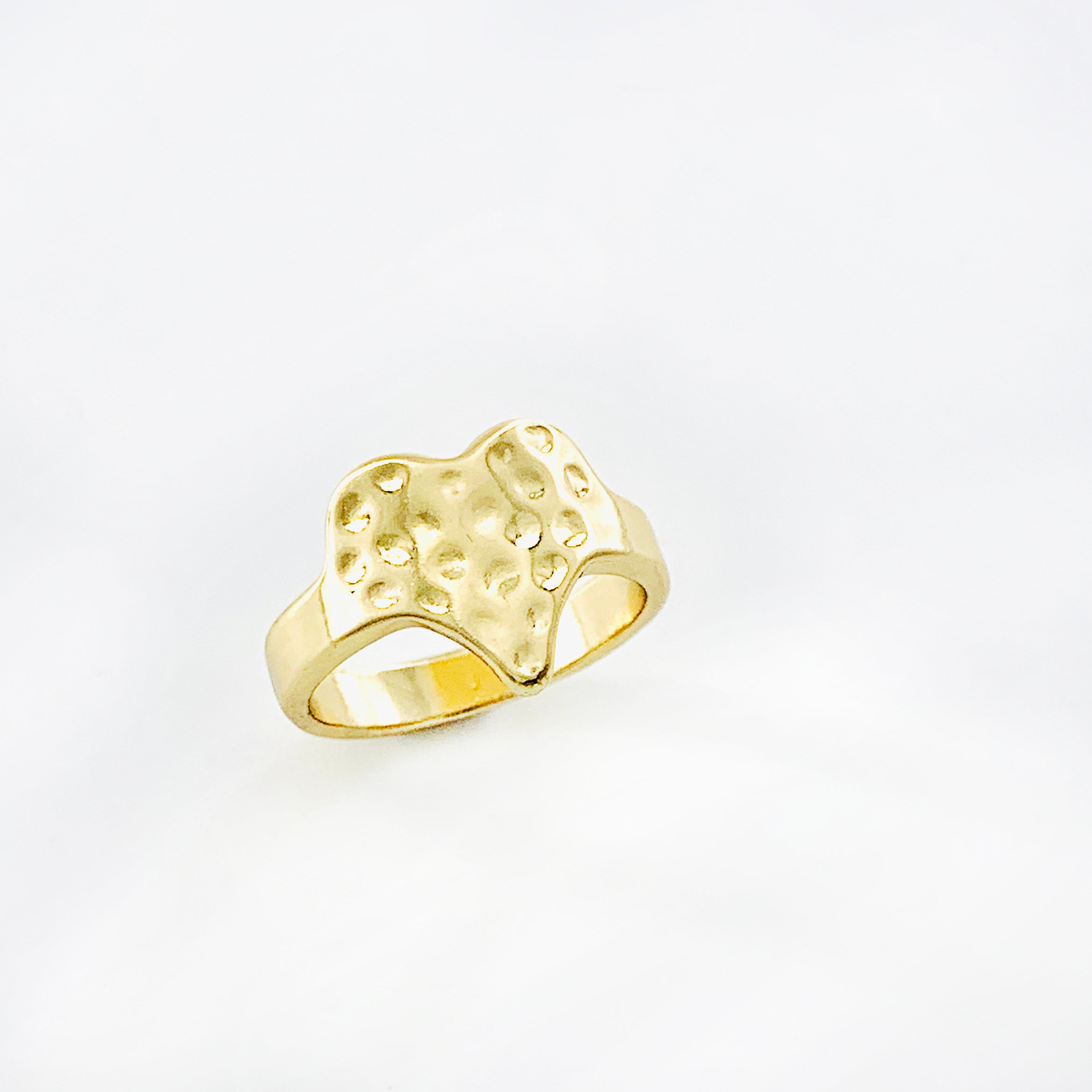 Gold ring with textured heart