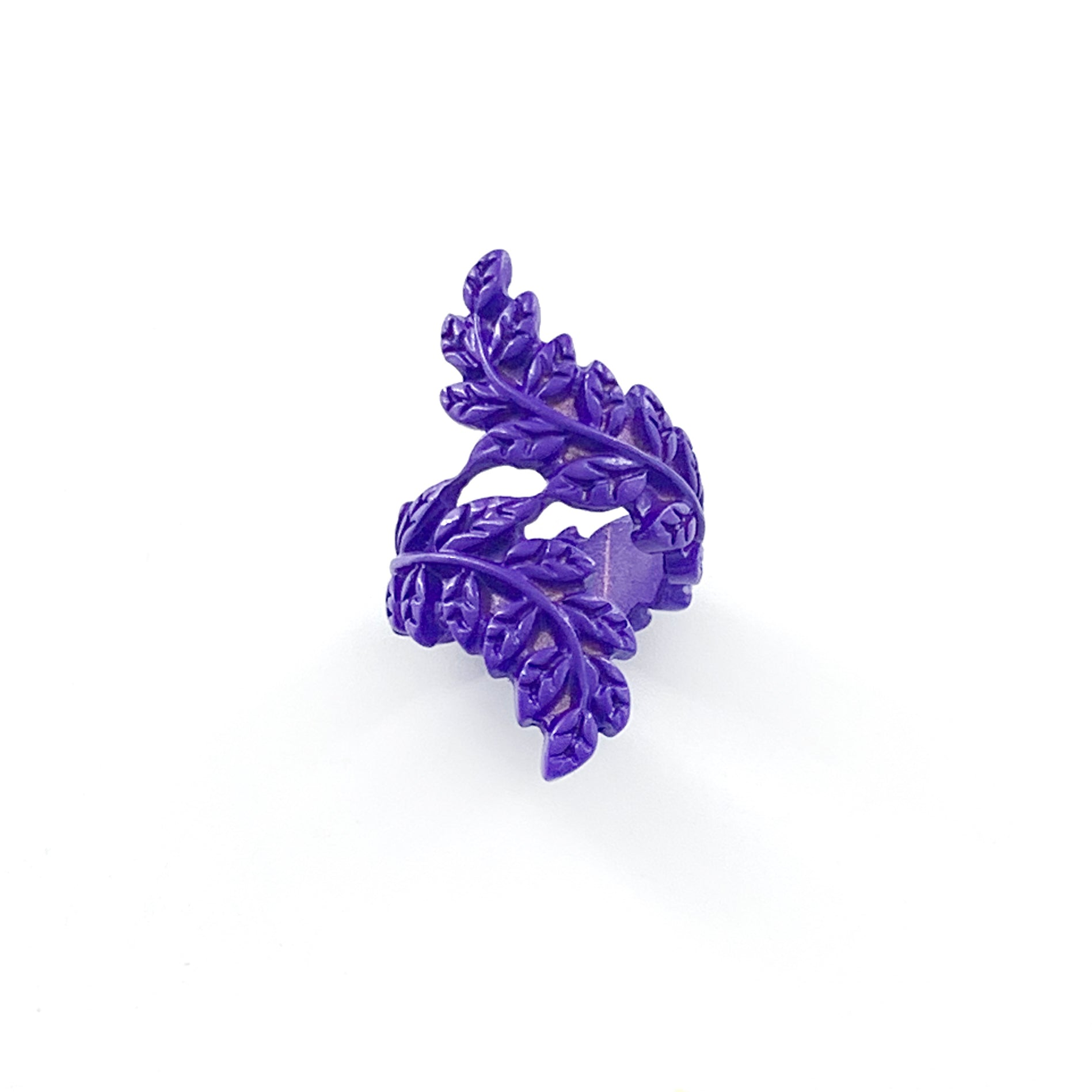 Purple coloured ring with twisted leafy design