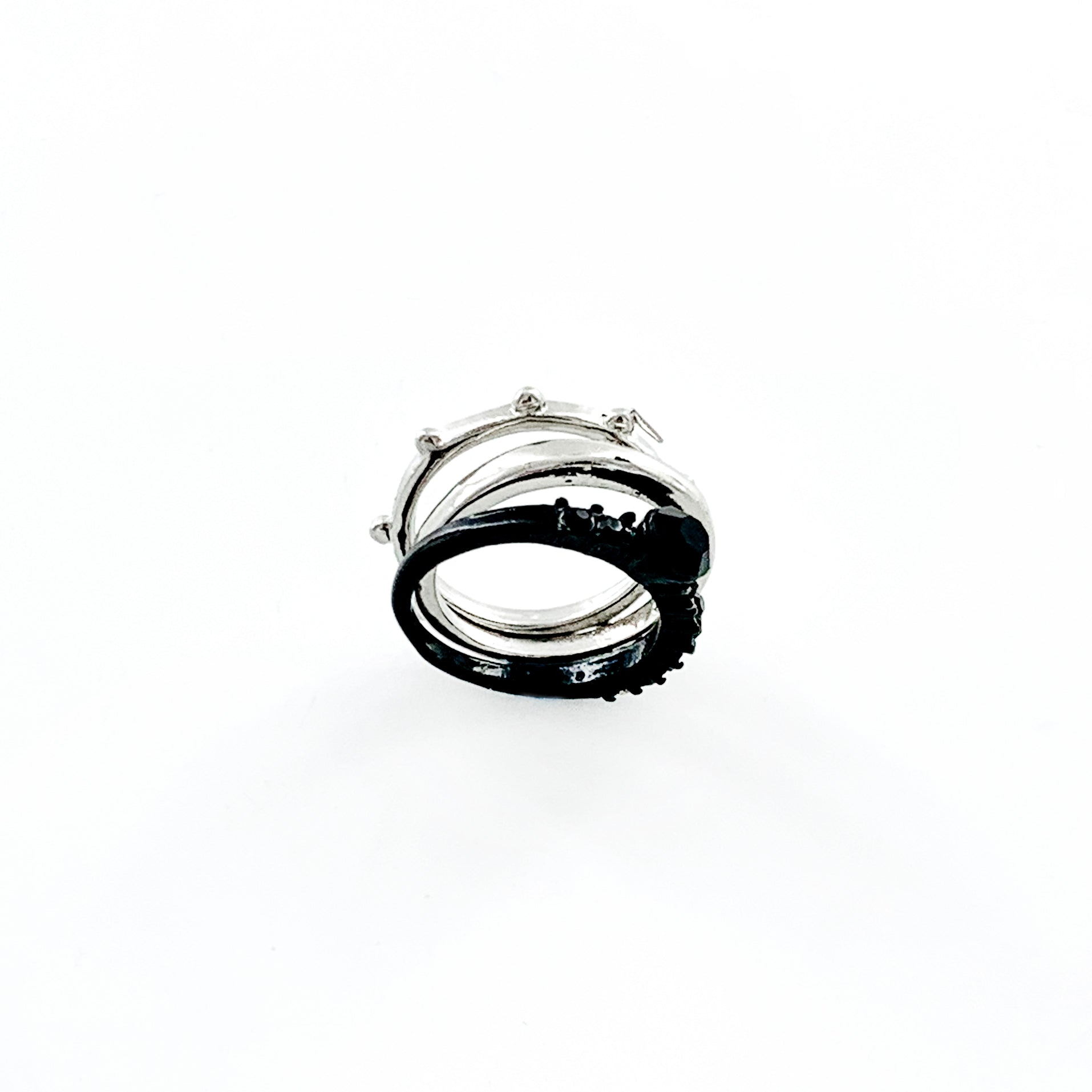 Triple rings in silver and black
