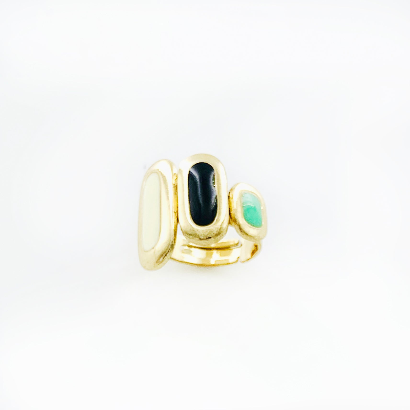 Gold ring with black, turquoise and white