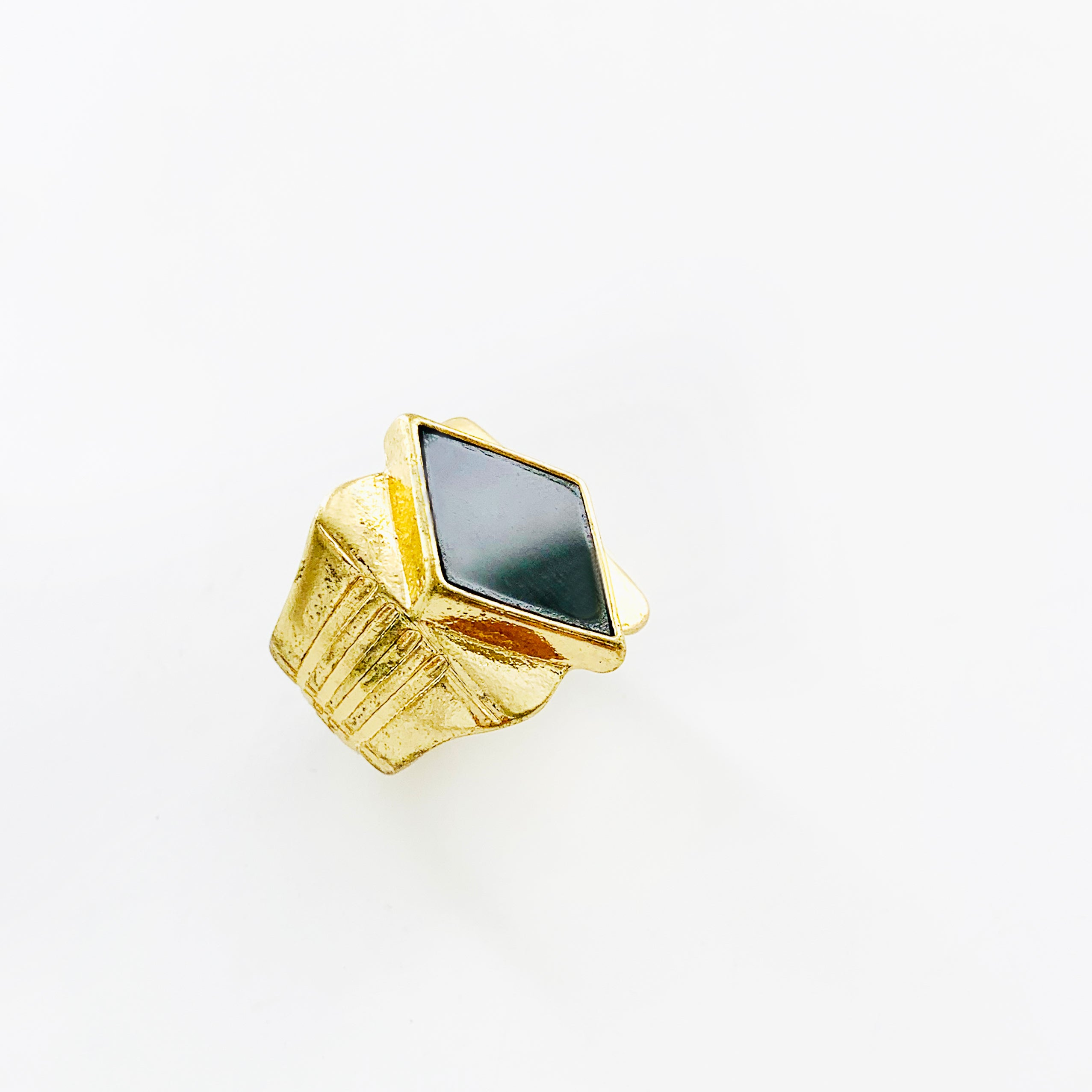 Chunky gold ring with diamond-shaped black stone