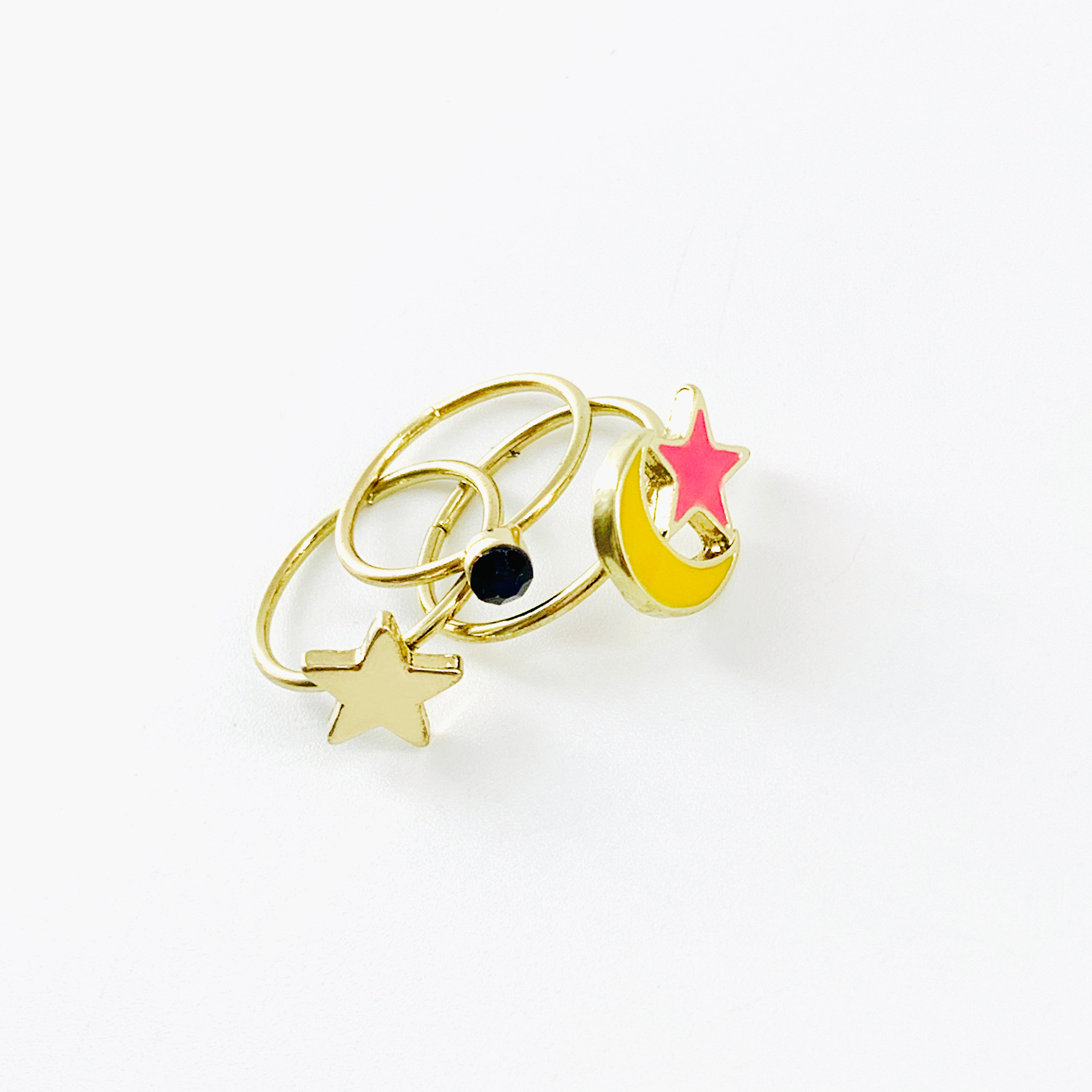 Gold pinky rings with yellow crescent and stars