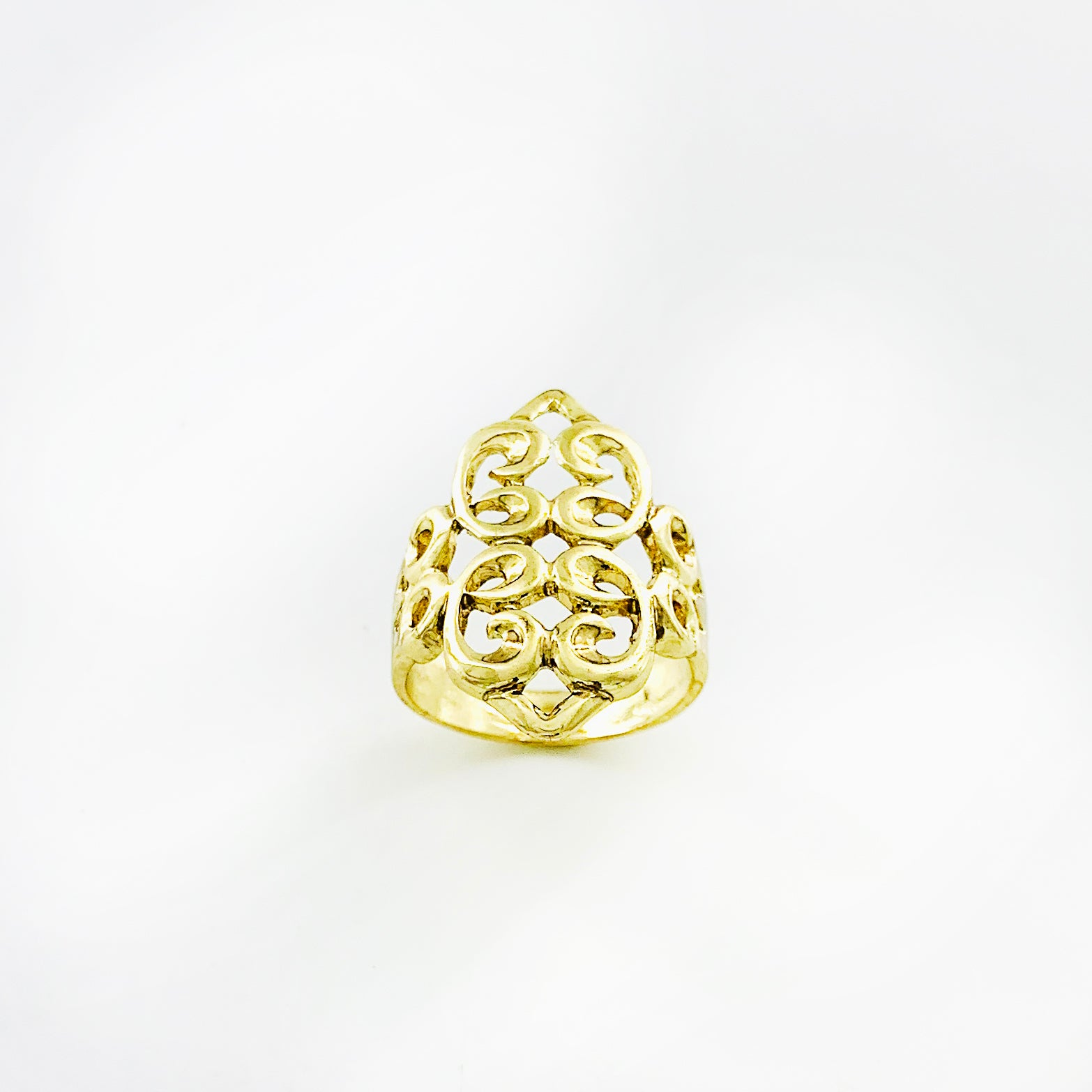 Gold ring with curly motif cut-outs
