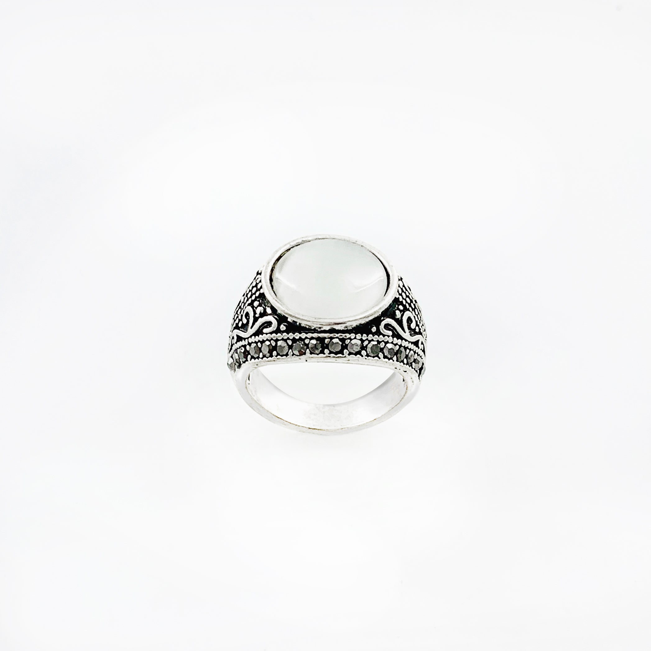 Art deco inspired silver ring with white cateye stone