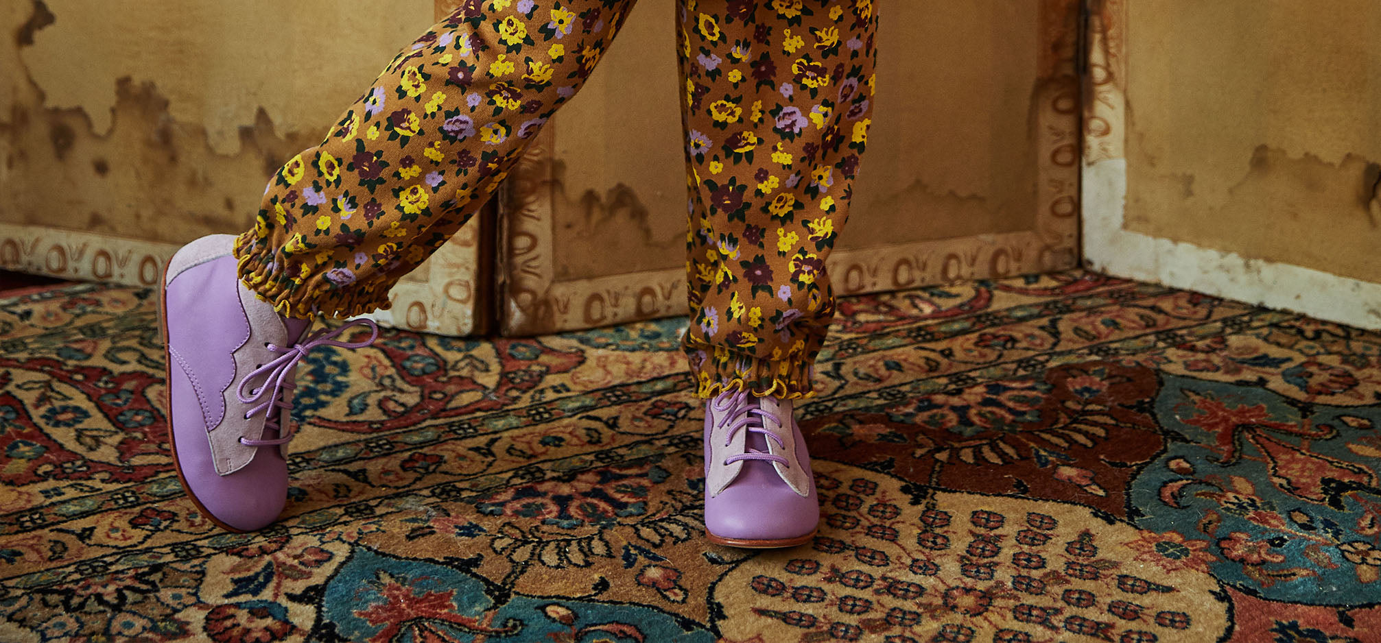 A girl wearing lavender purple boots.