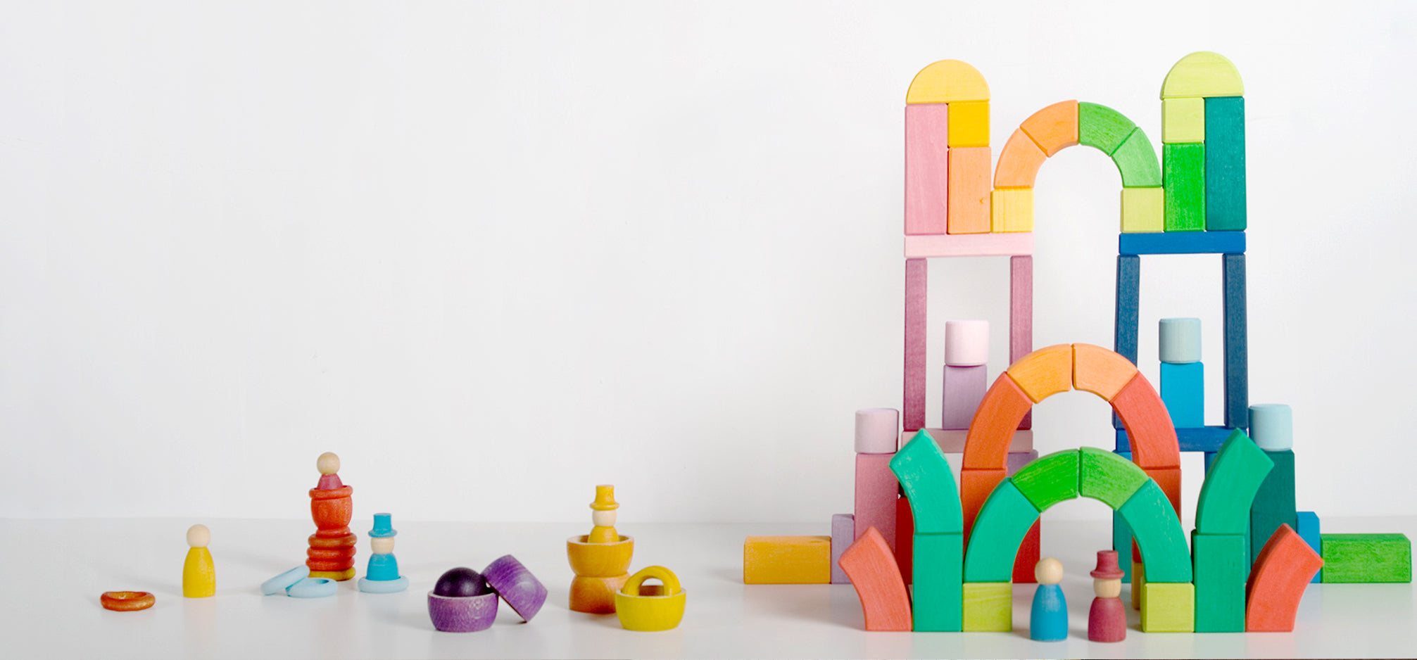 Stacks of colourful wooden blocks and toys.
