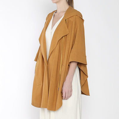 7115 By Szeki Woman Hooded Poncho Jacket Tumeric Orange