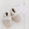 Pair of cream faux shearling baby booties.