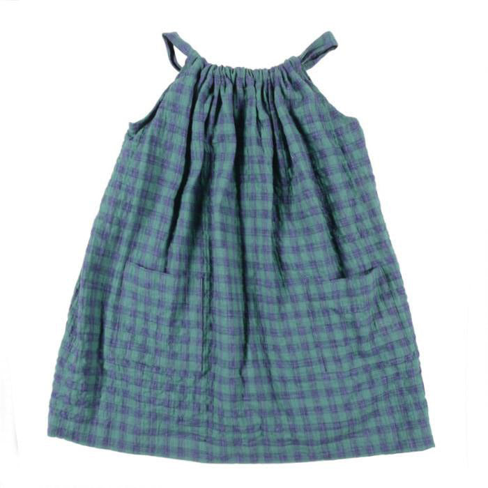 Wide dress with thin straps in a green and blue gingham fabric.