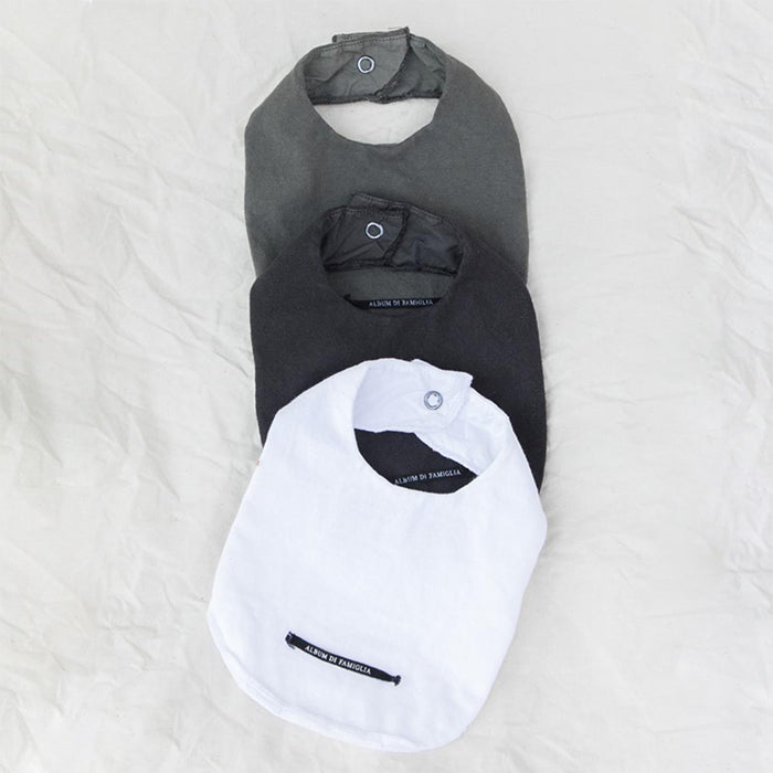Three monochrome baby bibs.