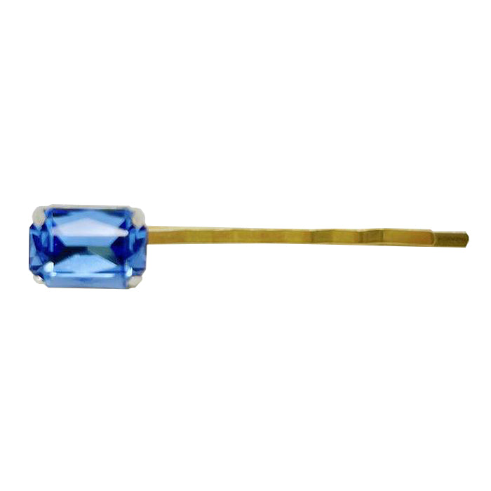 Bobby pin with sapphire blue coloured rhinestone.