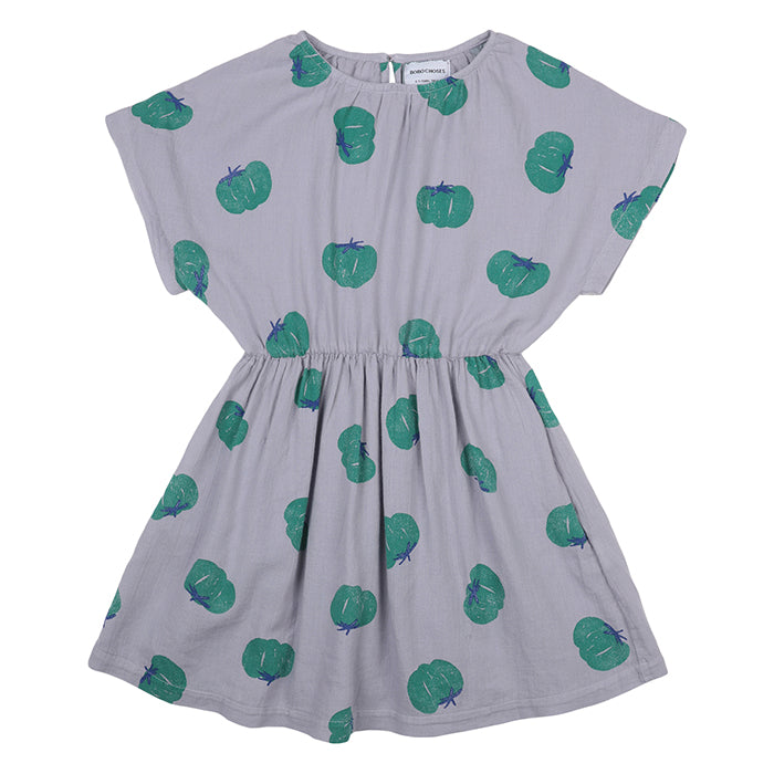 Short sleeved dress with gathered waist in purple with an all over green illustrated tomato print.