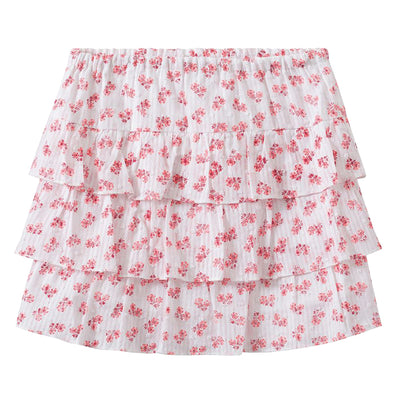 Short tiered skirt in white with an all over pink floral print on a textured Swiss dot cotton fabric with woven stripes.