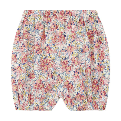 Long bloomers in an all over pink and blue floral print from the back.