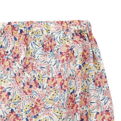 Close up of the elasticized waist and all over pink and blue floral print.