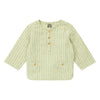 Long sleeved henley shirt with buttoned patch pockets in woven yellow stripes.