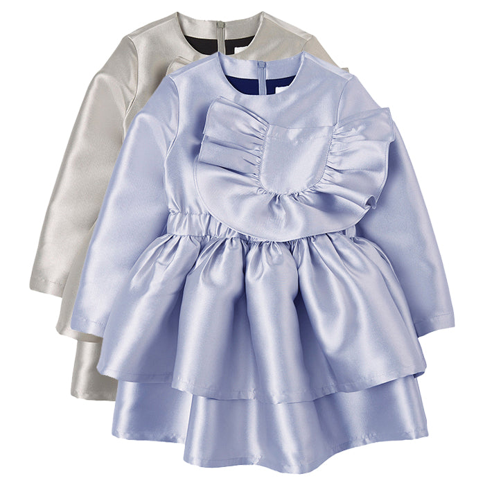 Two shiny long sleeved dresses with tiered skirts and a ruffled patch pocket on the chest.